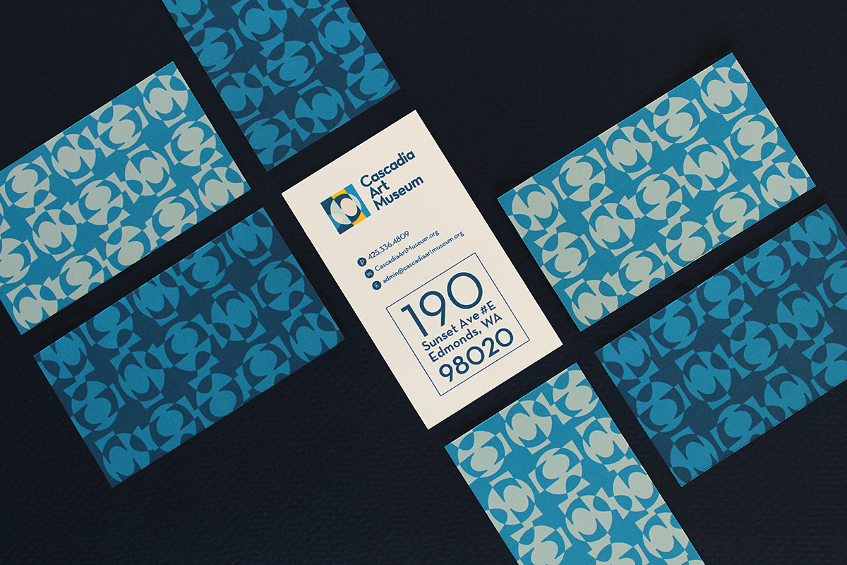 Business cards featuring custom pattern based on the logo as well as significant tile structures within the CAM galleries