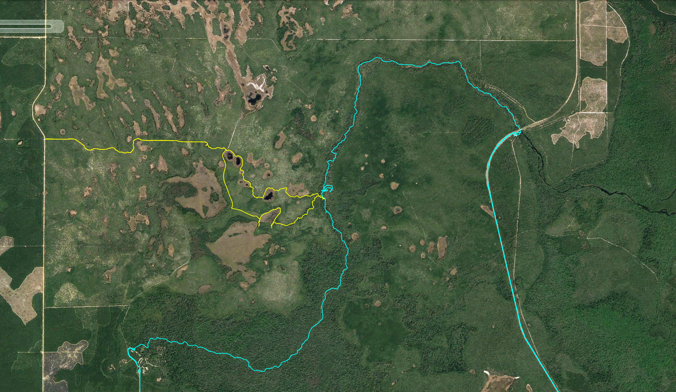 Here is a Google Earth screenshot of our two trips, which I recorded with my Garmin. The blue path is from our kayaking scouting trip. The yellow path is from mine and Alex's most recent trip where we navigated to the river via land.
