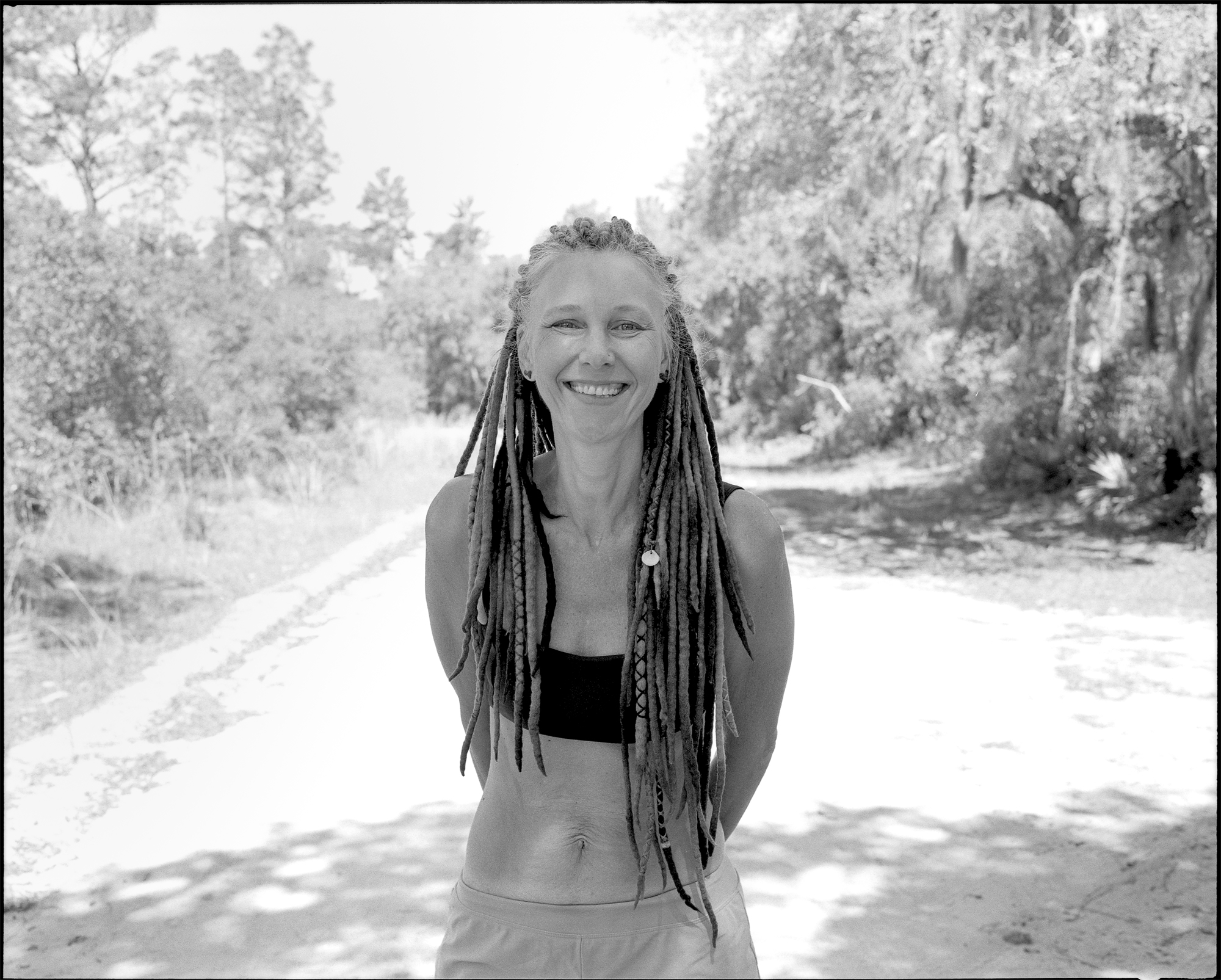 Krysten Nelson smiles for a portrait at the Pat's Island Trailhead parking lot. You can follow her Instagram account  @thehennahighway . Shot details: Mamiya 7ii, 80mm f/4, Kodak Tri-X 400 pushed to 1600