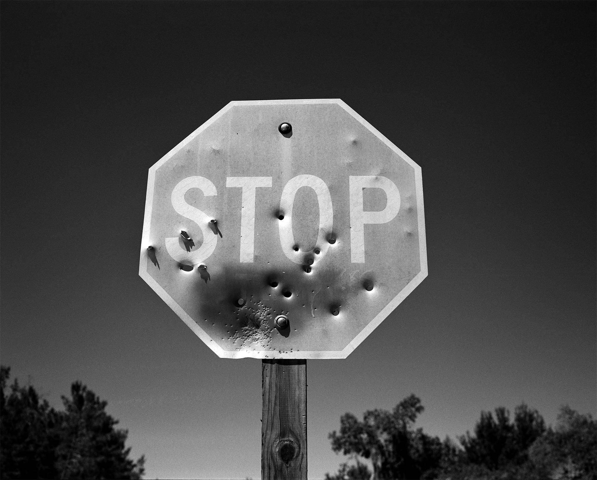 Shot up stop sign on the outskirts of the Juniper Prairie Wilderness. Shot details: Mamiya 7ii, 80mm f/4, #25 red filter, Kodak Tri-X 400 pushed to 1600