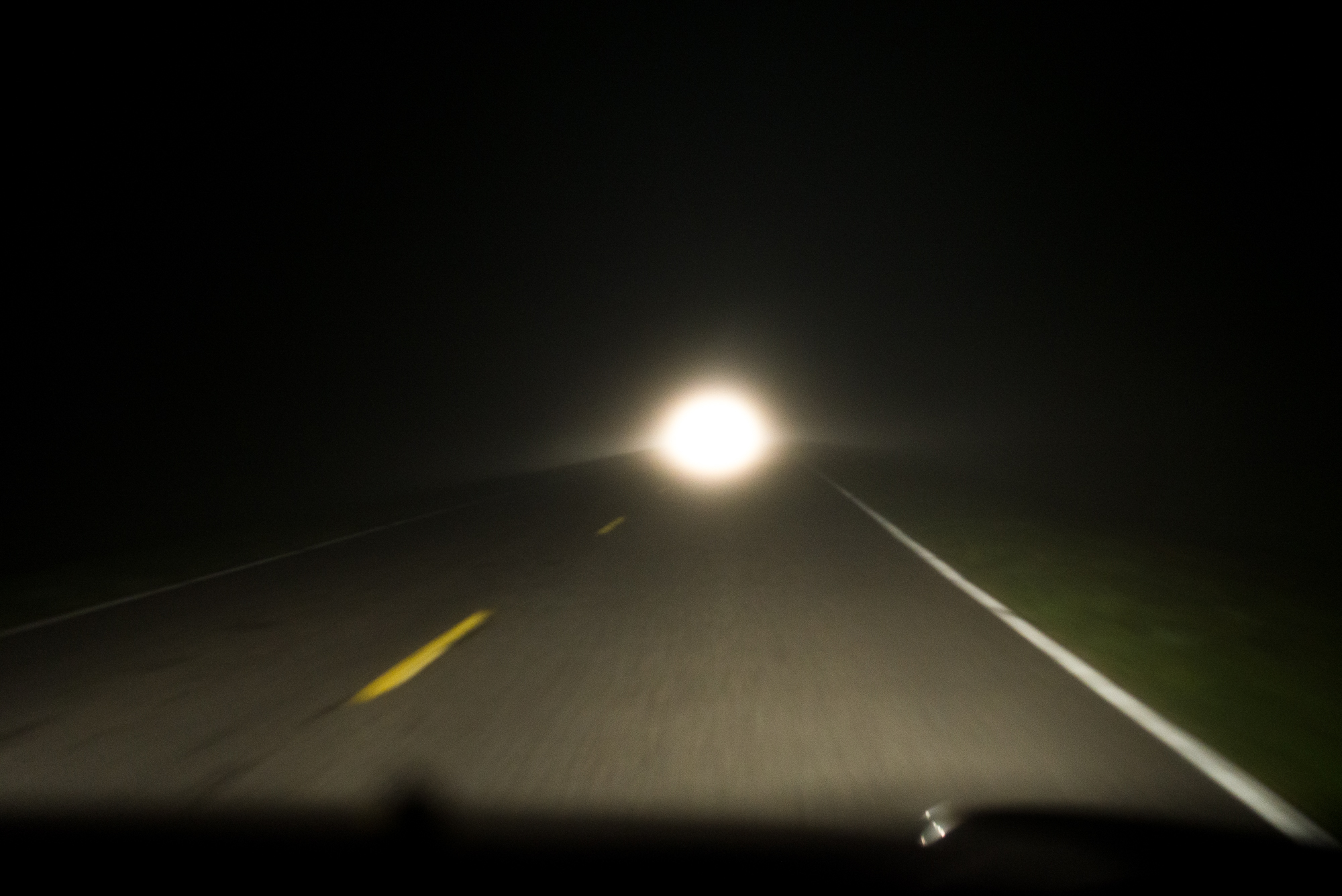 The headlights of a passing vehicle foreshadow the dawn of a new era in our Juniper Prairie Wilderness adventures.