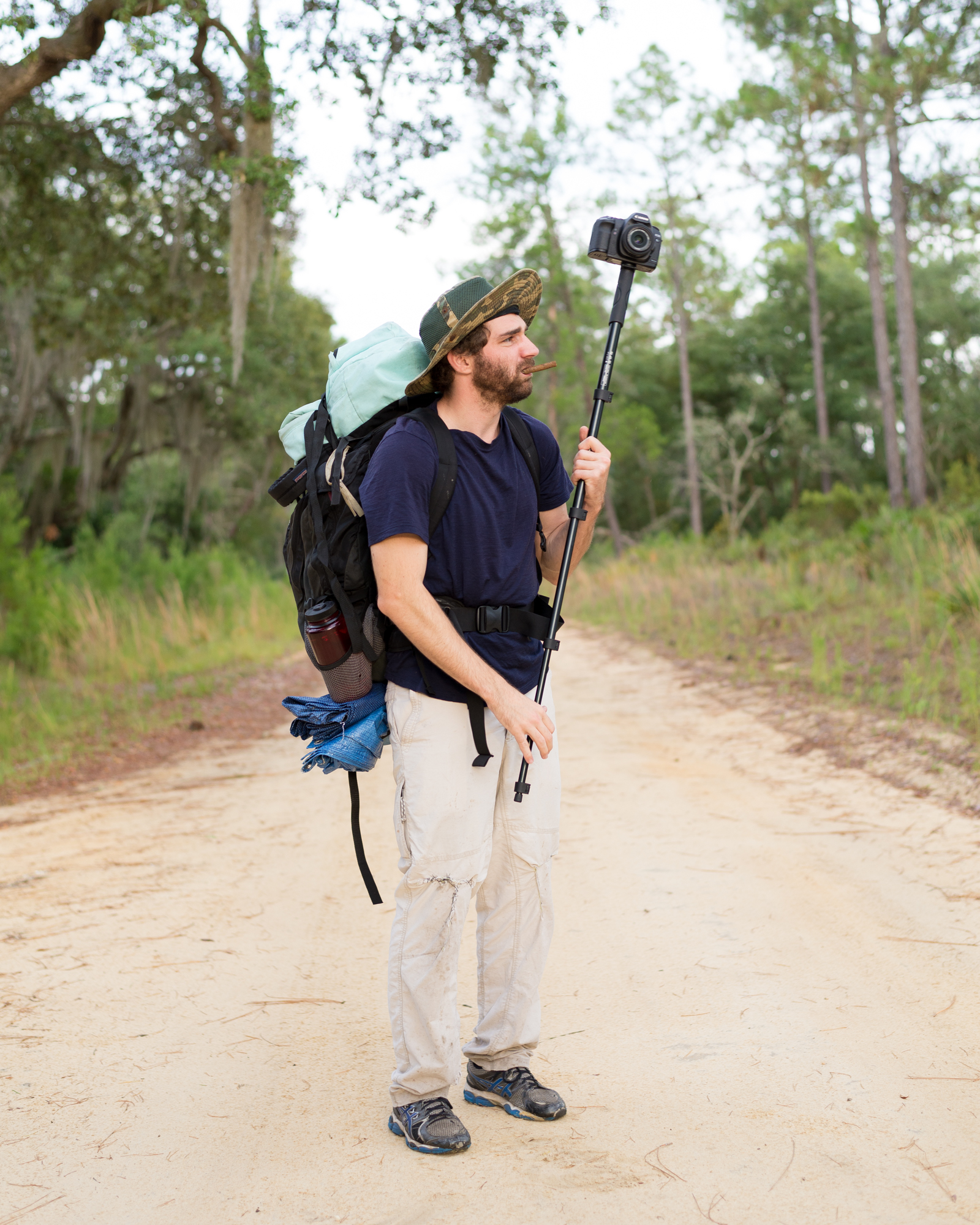 Alex pauses for a portrait in the middle of Forest Road 46 before hiking south into the Juniper Prairie Wilderness.
