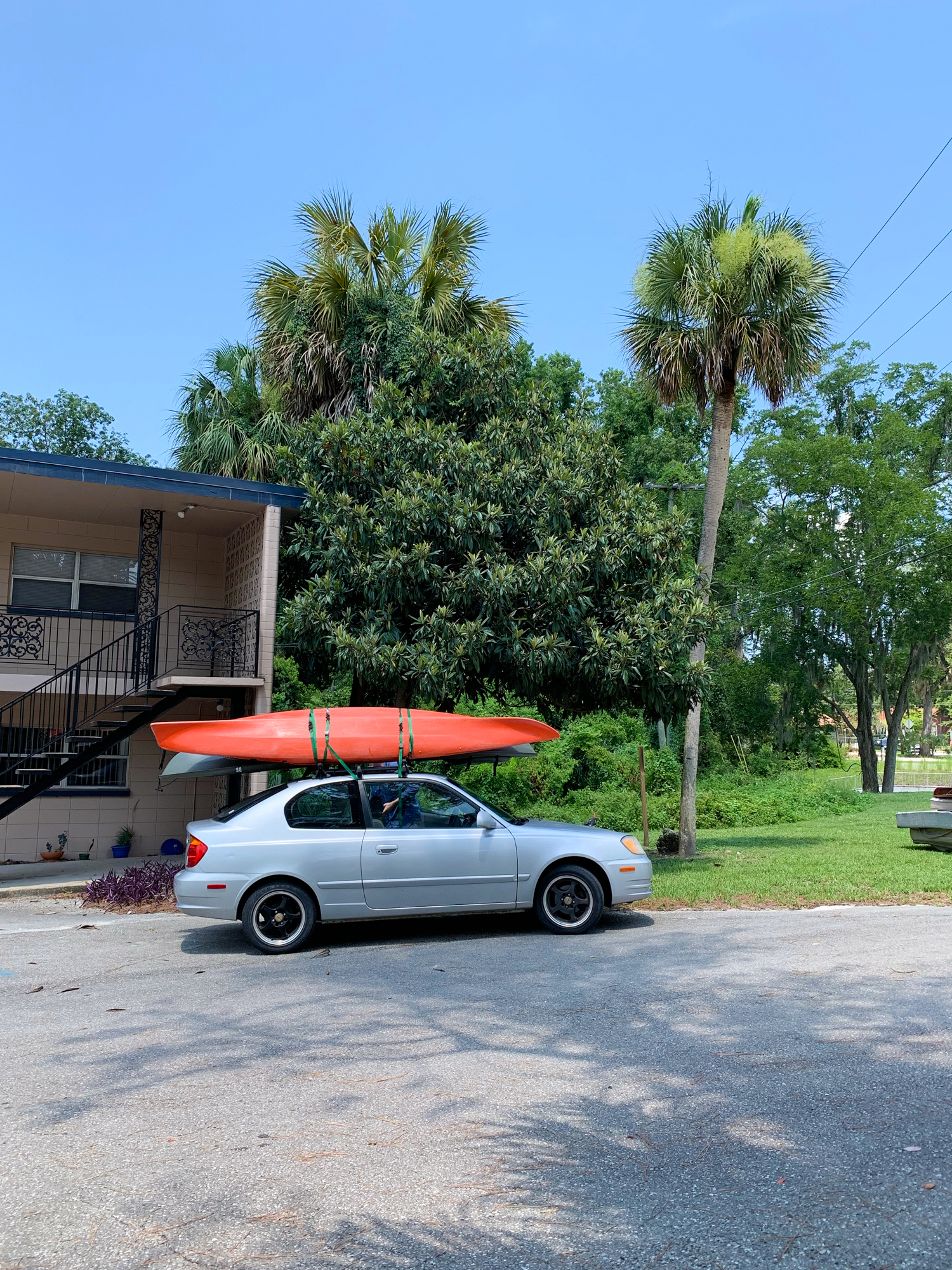 Our kayaks loaded on the roof of Alex's Hyundai Accent.