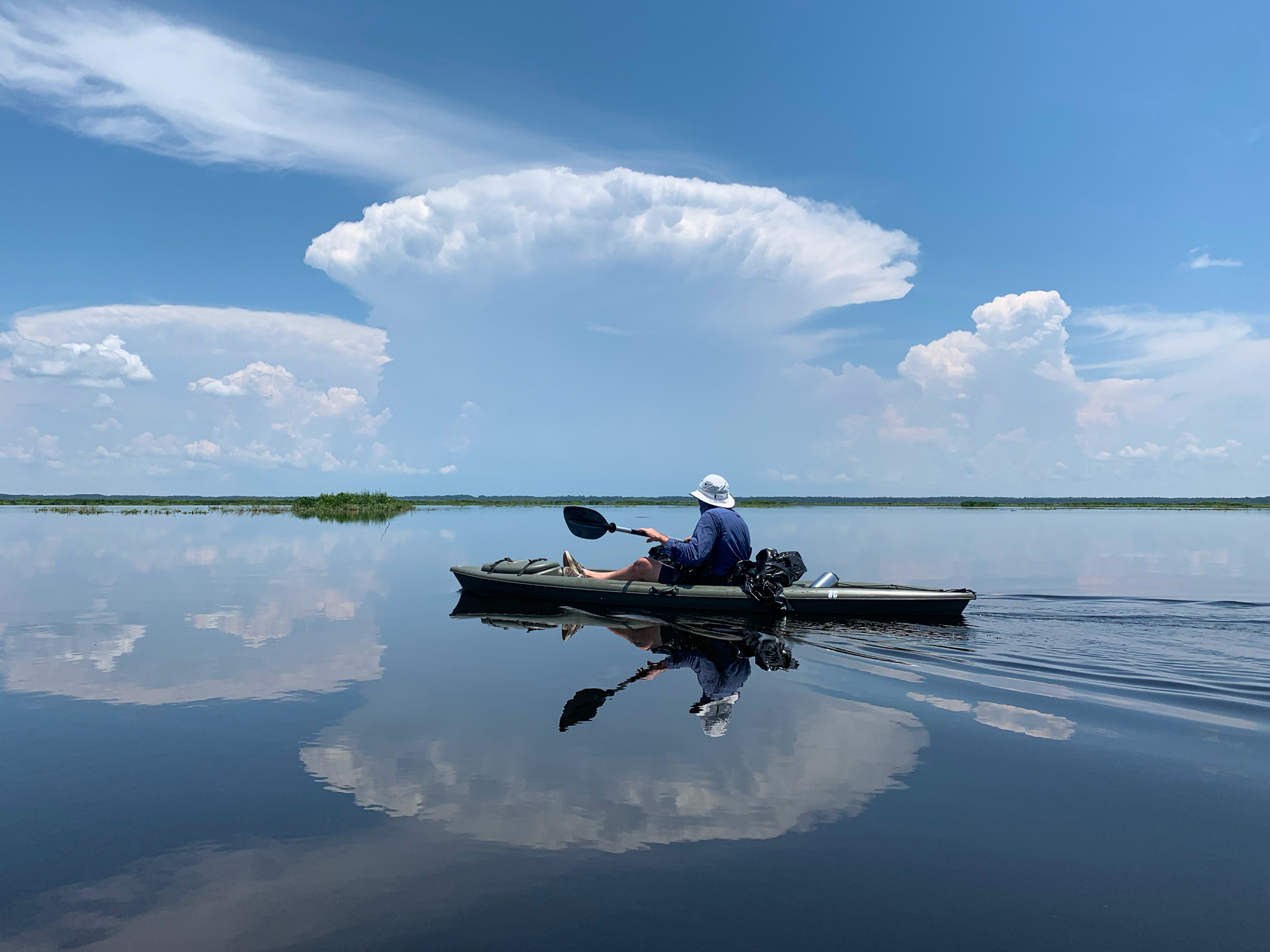 A large storm looms in the distance during our paddle out to the La Chua Trail observation platform in Paynes Prairie Preserve.