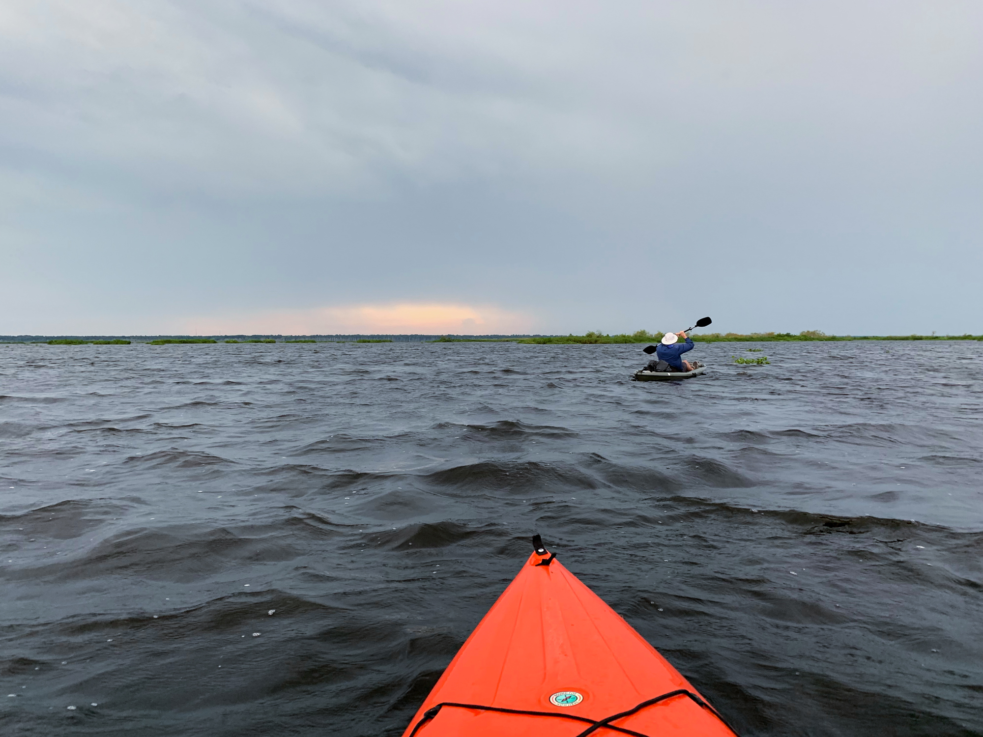Alex and I paddle back toward the car. The storm made the water feel more like an ocean than a lake.