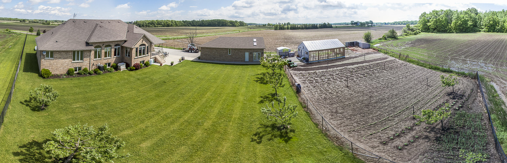 Panoramic photo of a backyard with a large garden (or small farm) near Hamilton, Ontario.