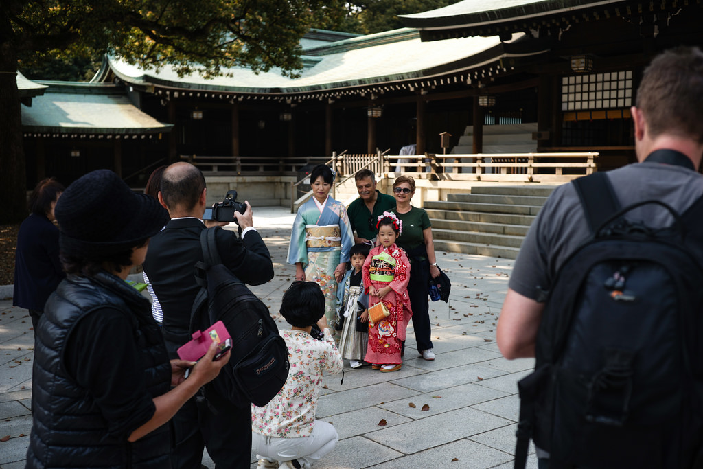 The family in the kimono was visiting the temple and became the attraction.