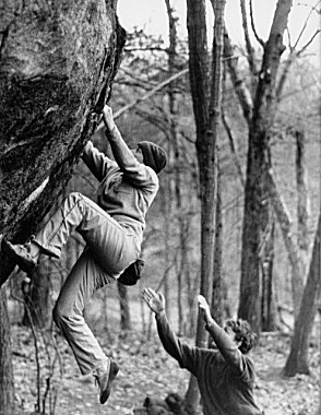 Janet Bergman climbing at Lincoln Woods, Rhode Island, while Rio Rose provides the supportive spot.