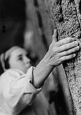 "Anne did a series of hand shots because as she says, ""the hands are so beautiful and crucial to climbing."" Here, Janet Bergman grabs a sidepull at Pawtuckaway, New Hampshire."