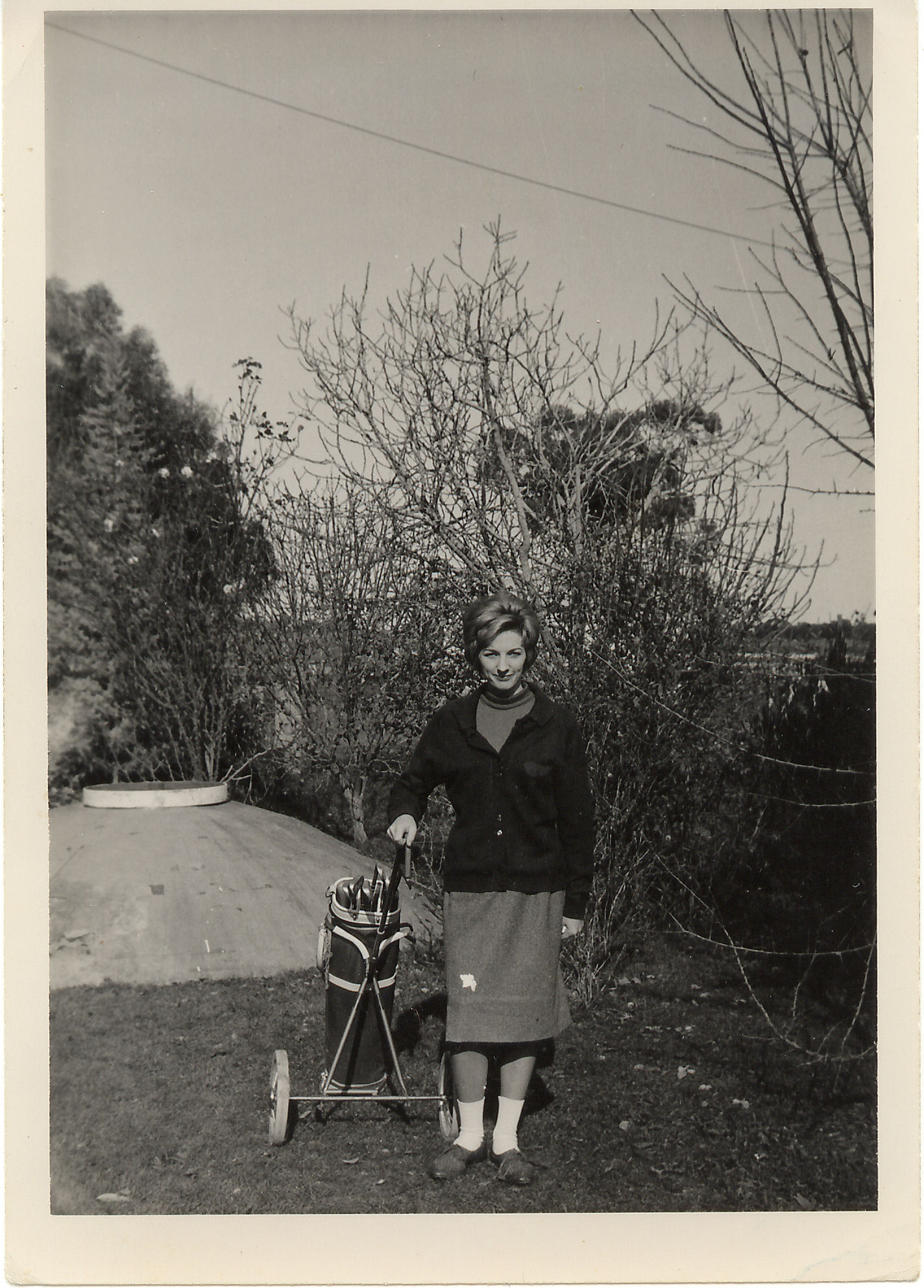 Mum in golfing attire on the farm.jpg