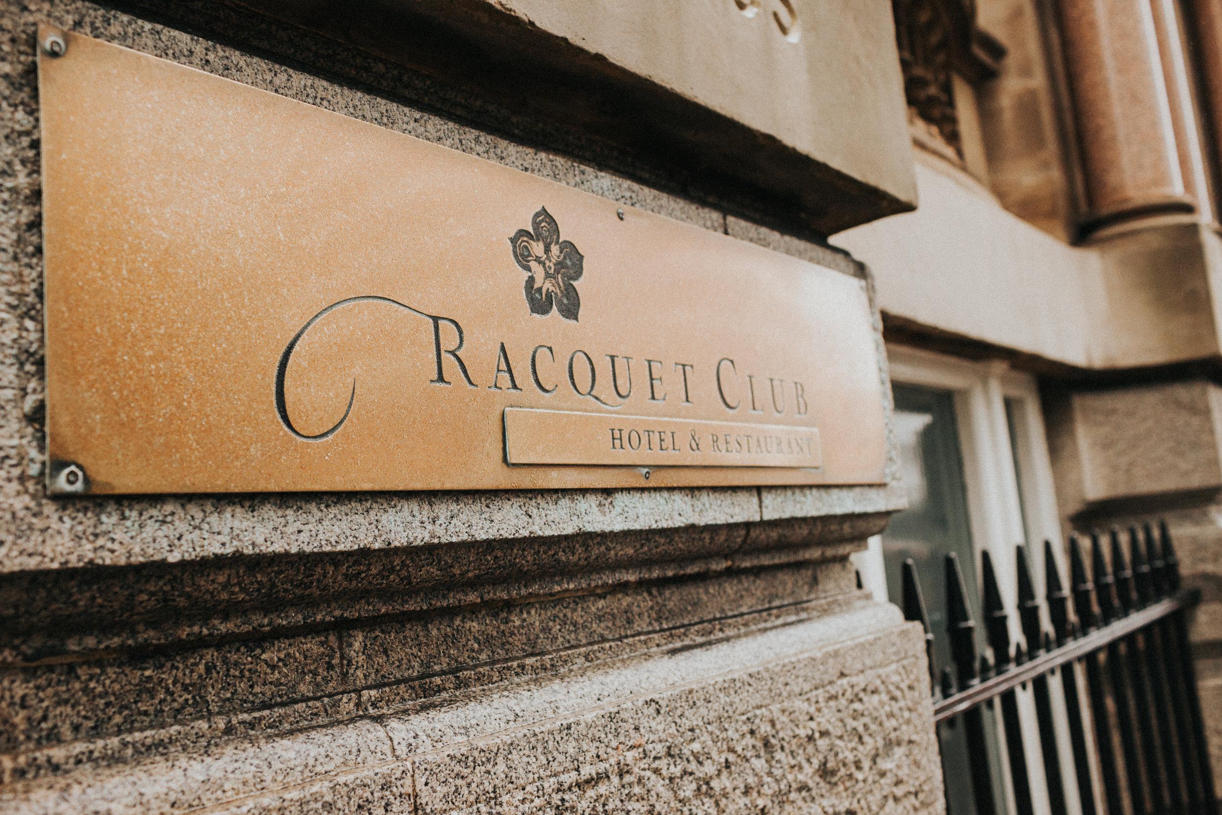 Racquet Club sign