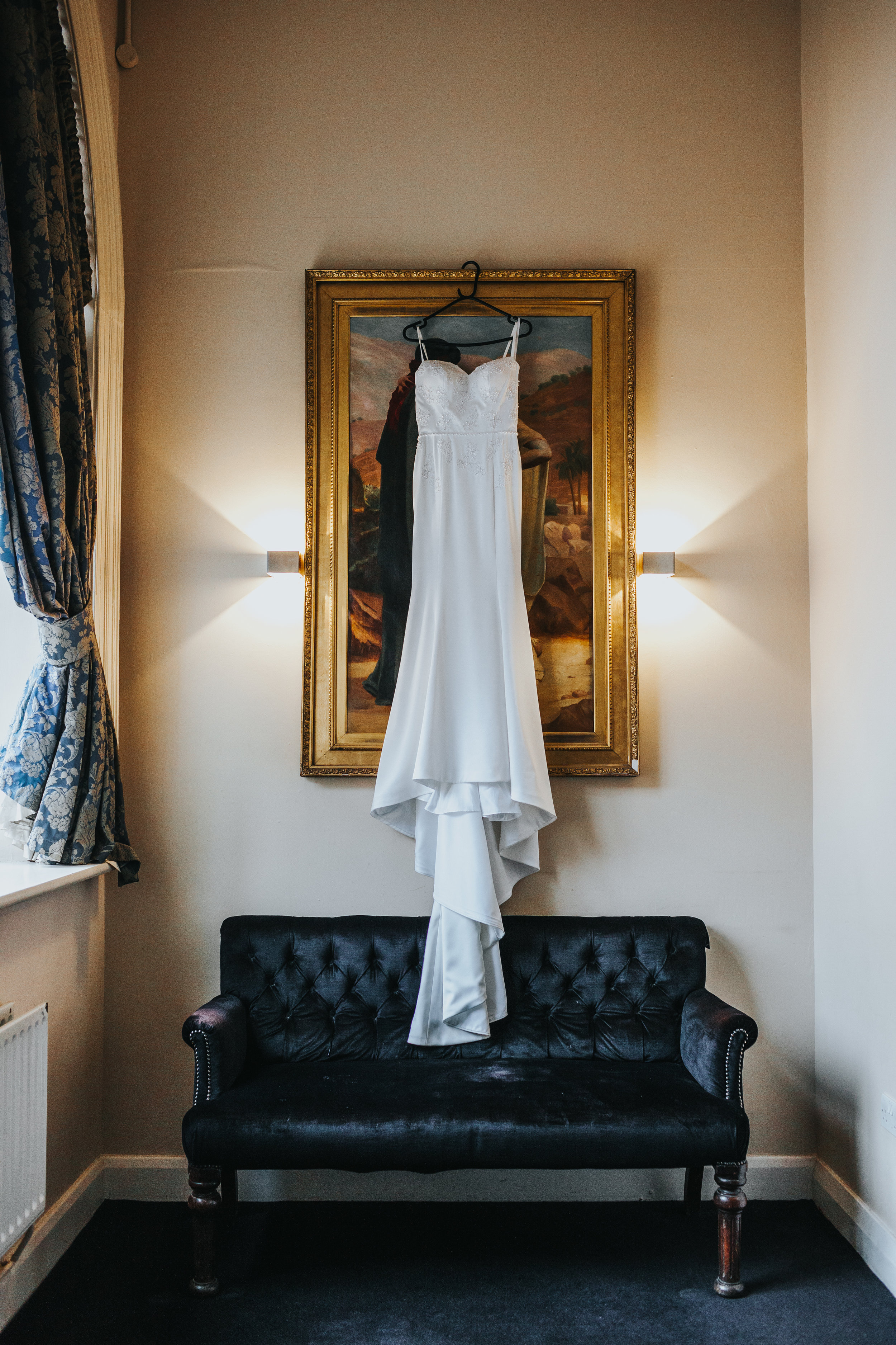 Dress hanging on painting