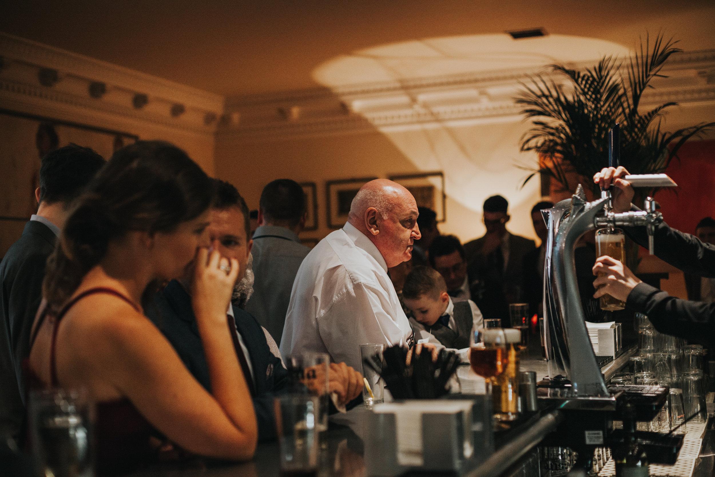 Guests waiting at bar