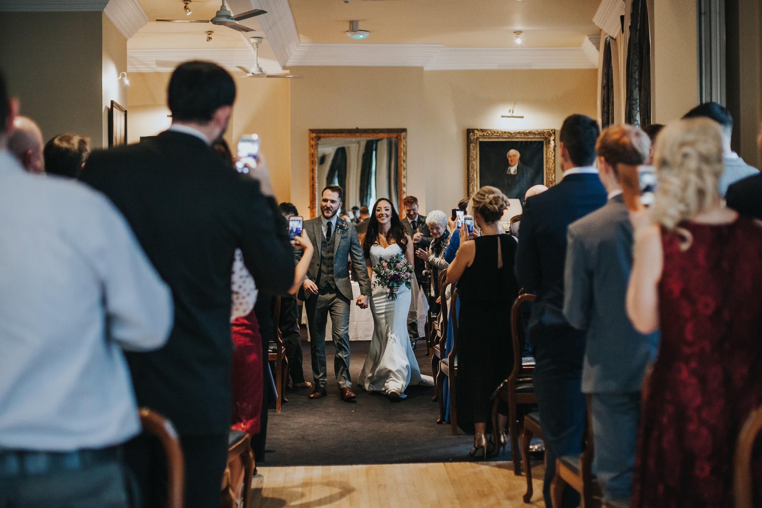 Bride and groom exit wedding