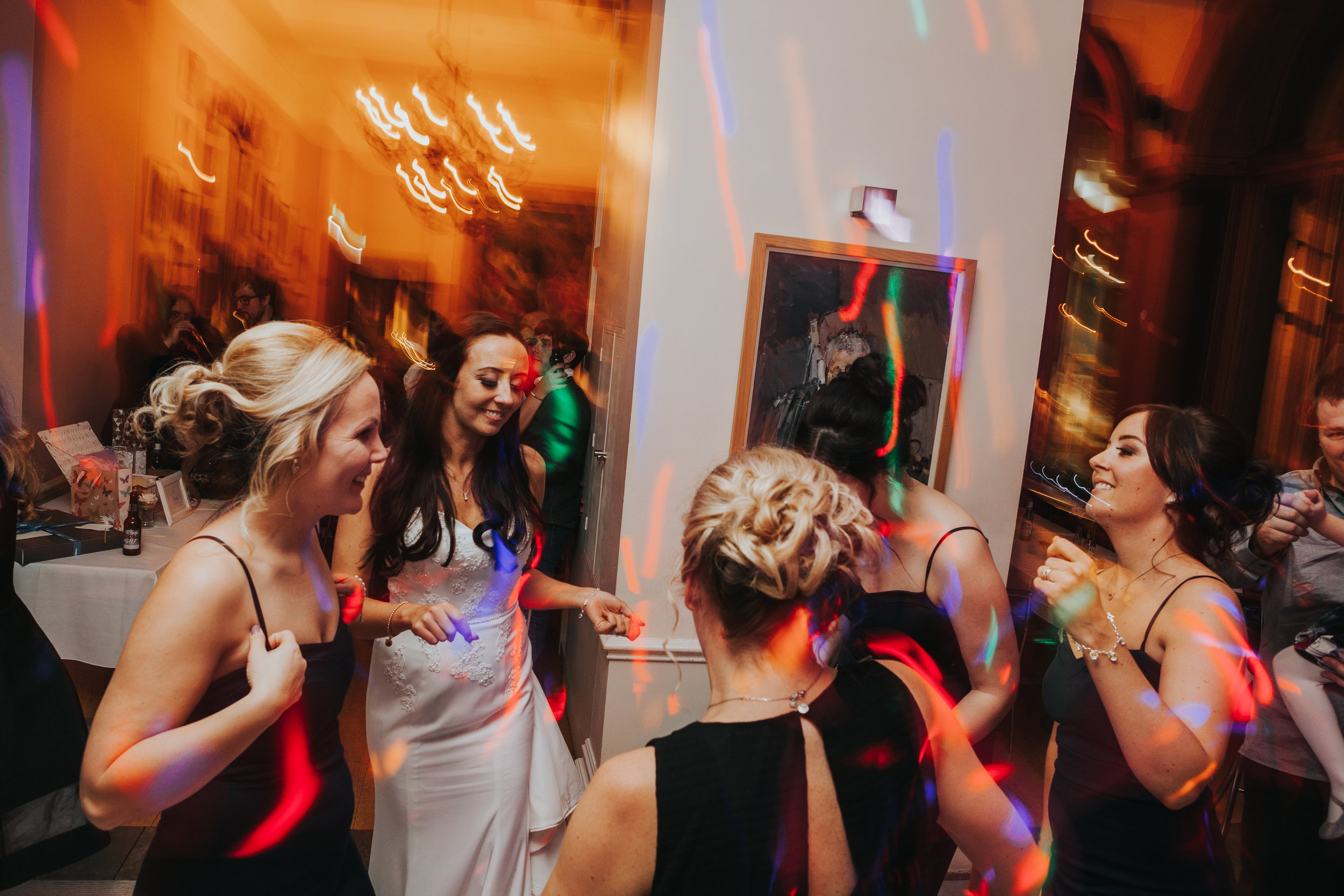 Bridesmaids dancing together at The Racquet Club