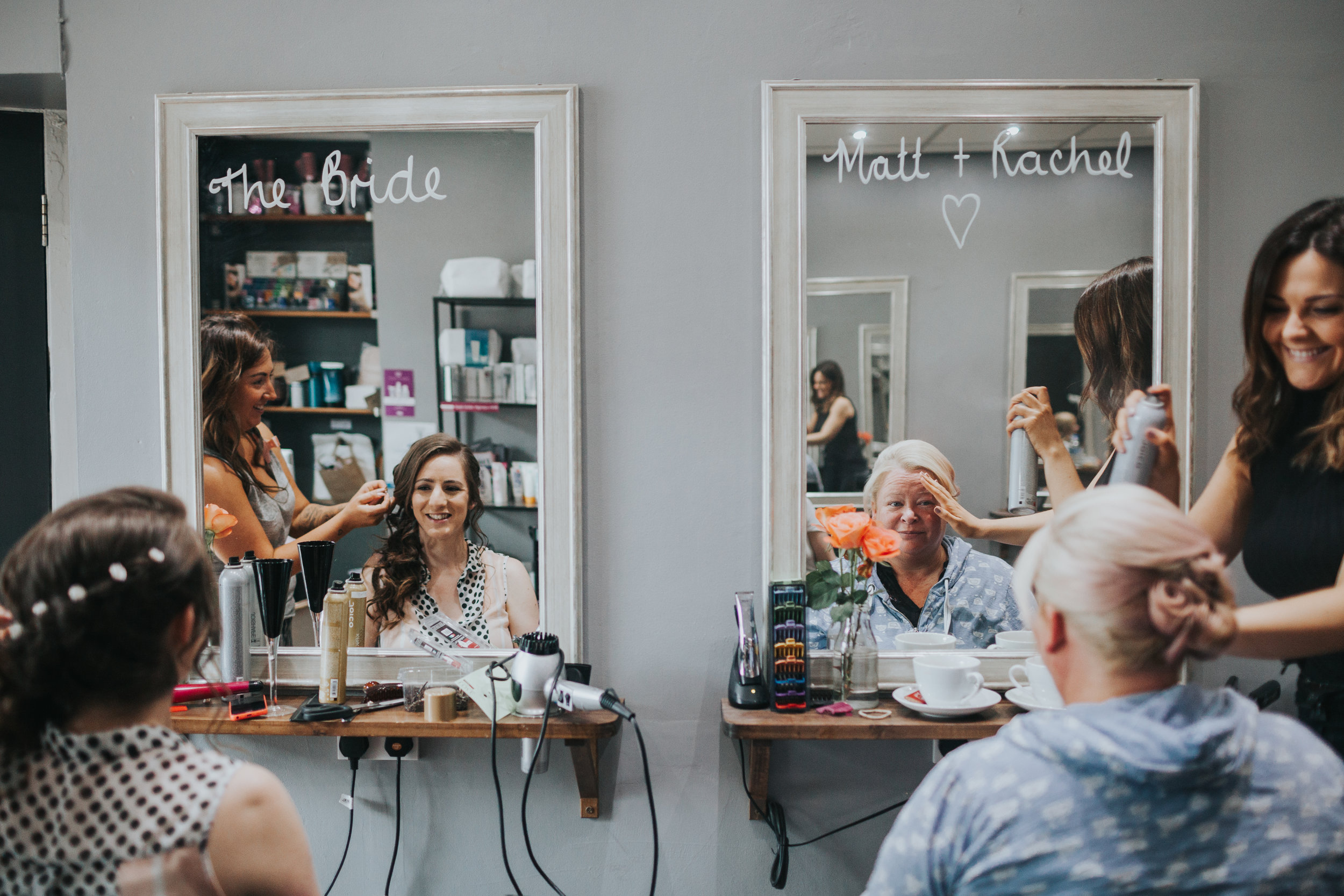 Bride and Maid of Honour get hair done, reflections in mirrors