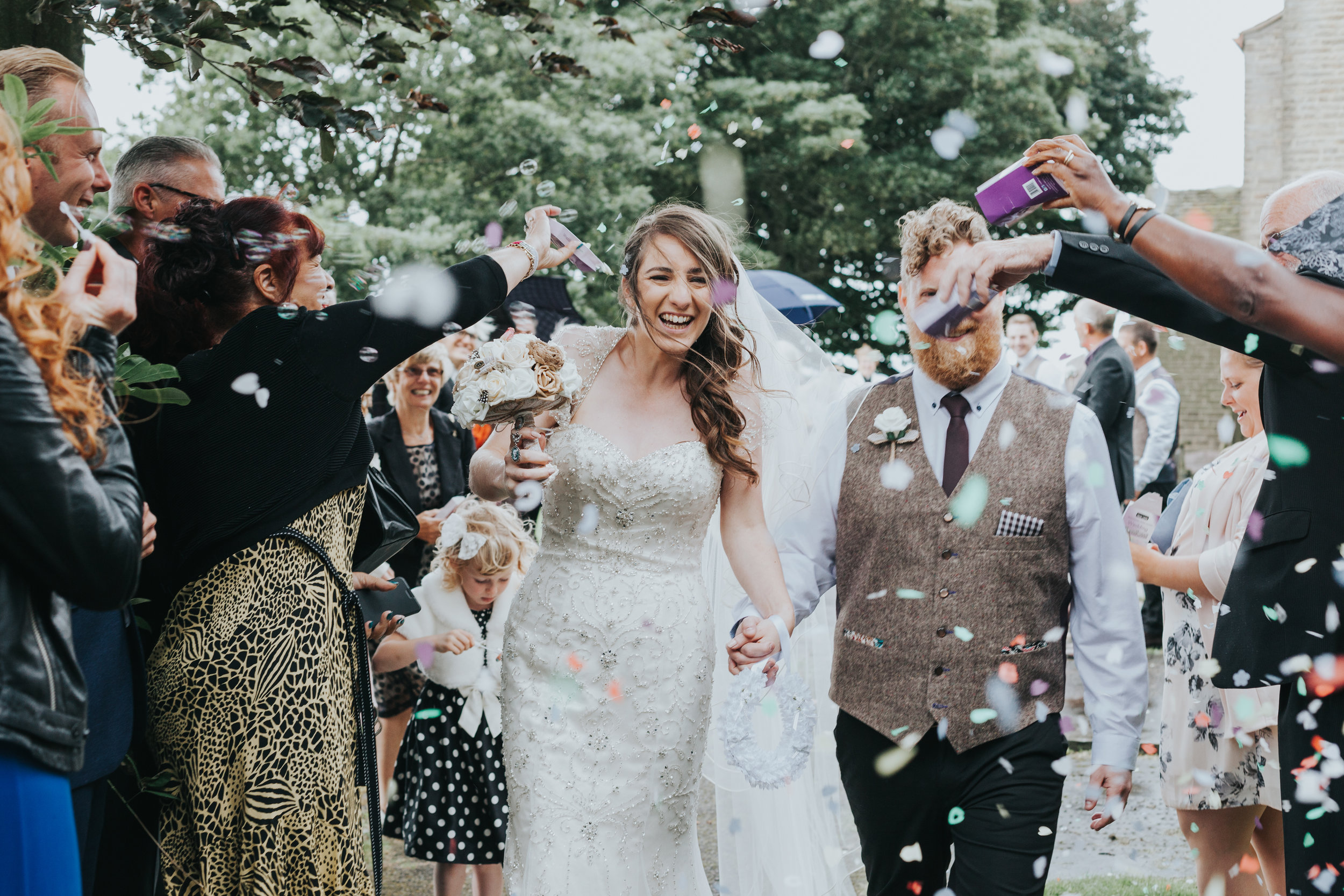 New Weds are attacked with confetti.