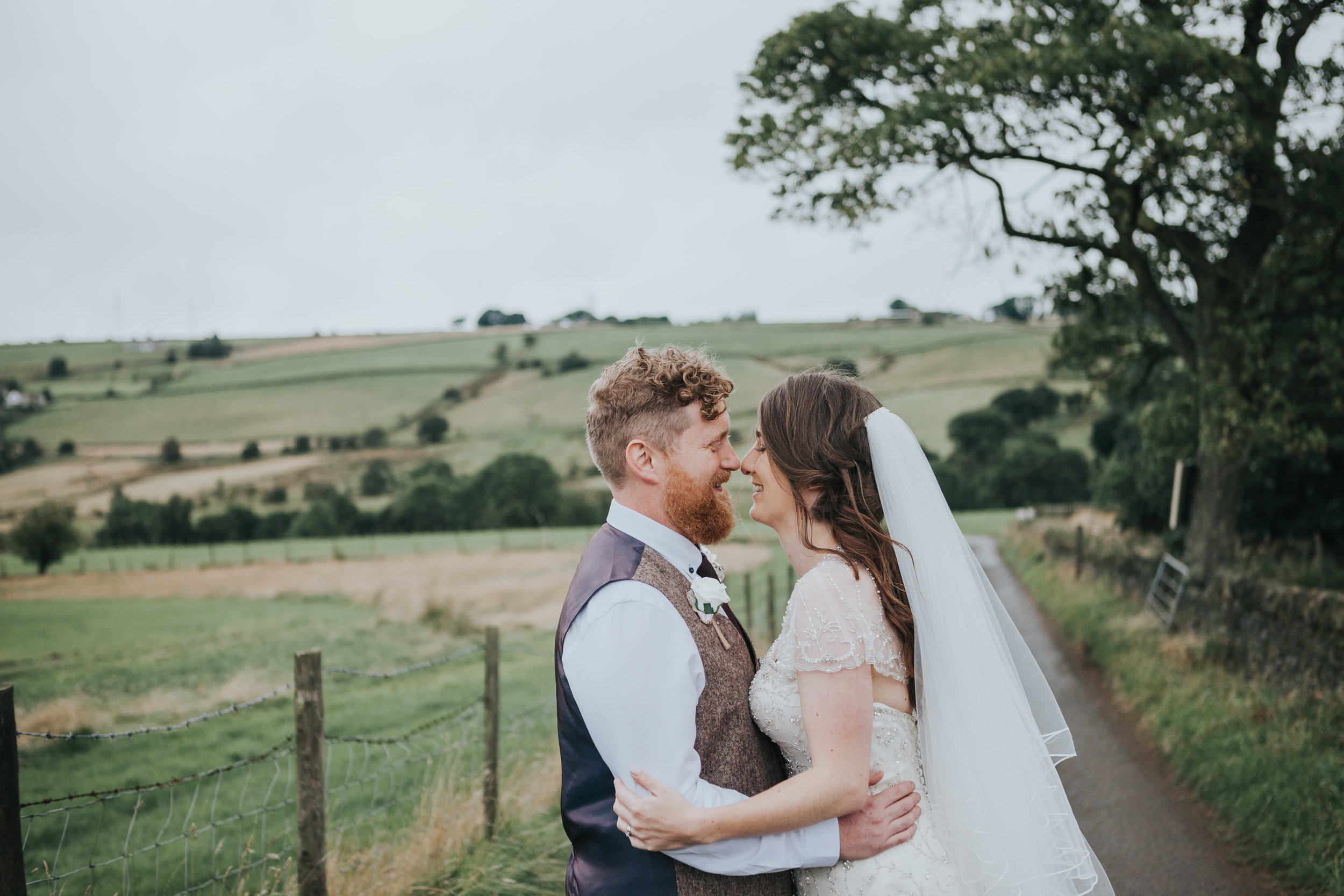 Bride and Groom portrait over rolling hills