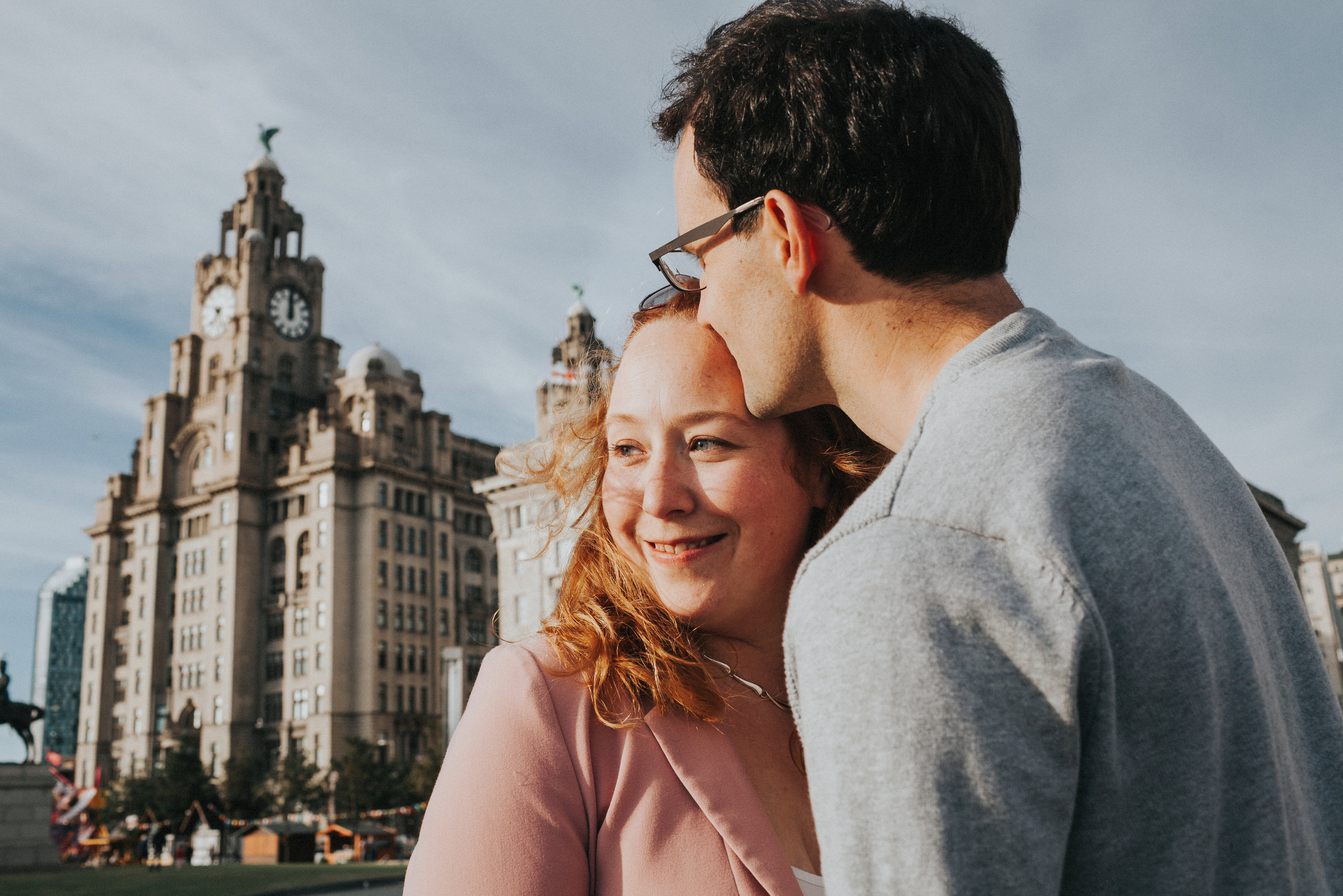 Couple in front of Liver Buildings smiling
