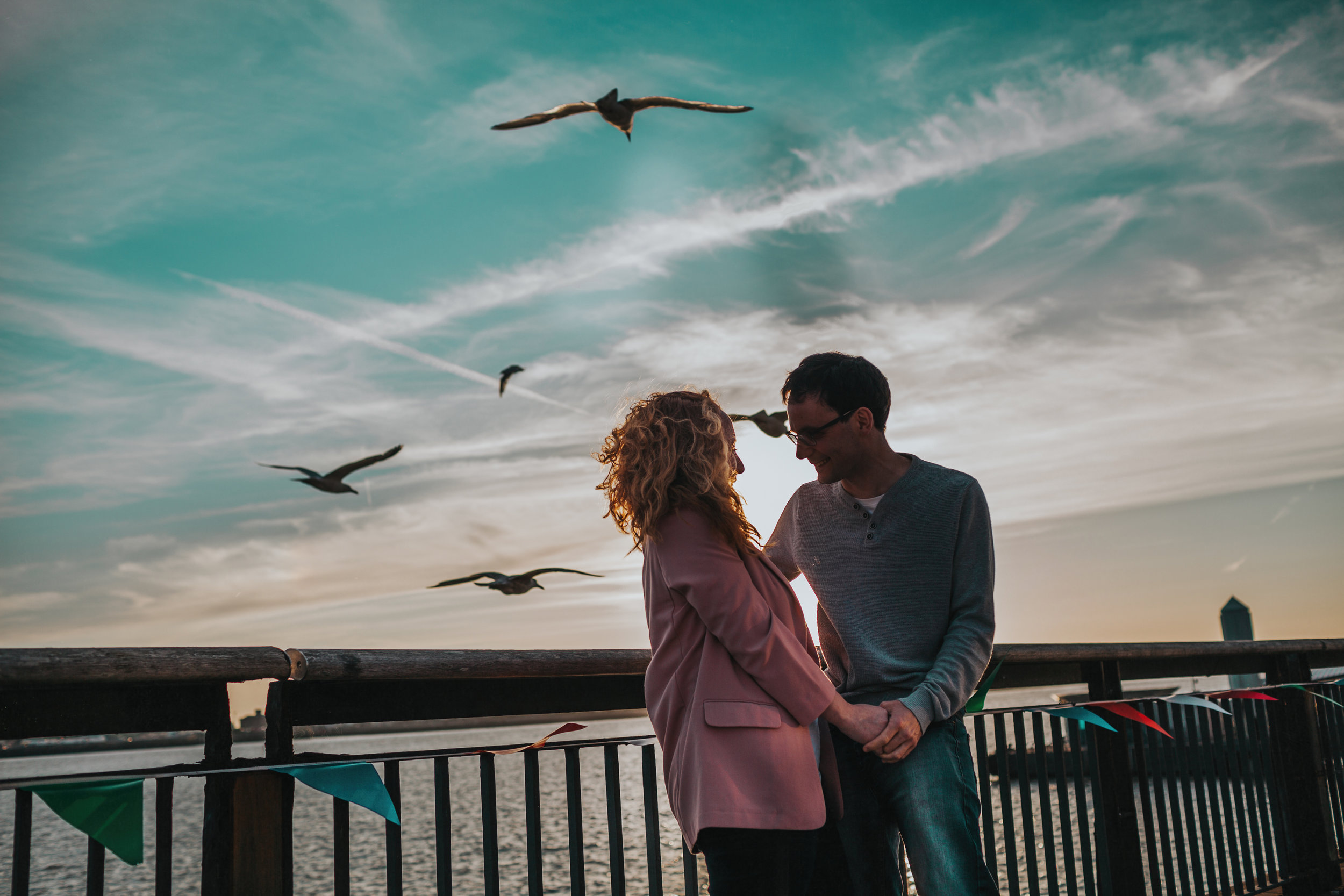 Couple with Seagulls and blue sky.