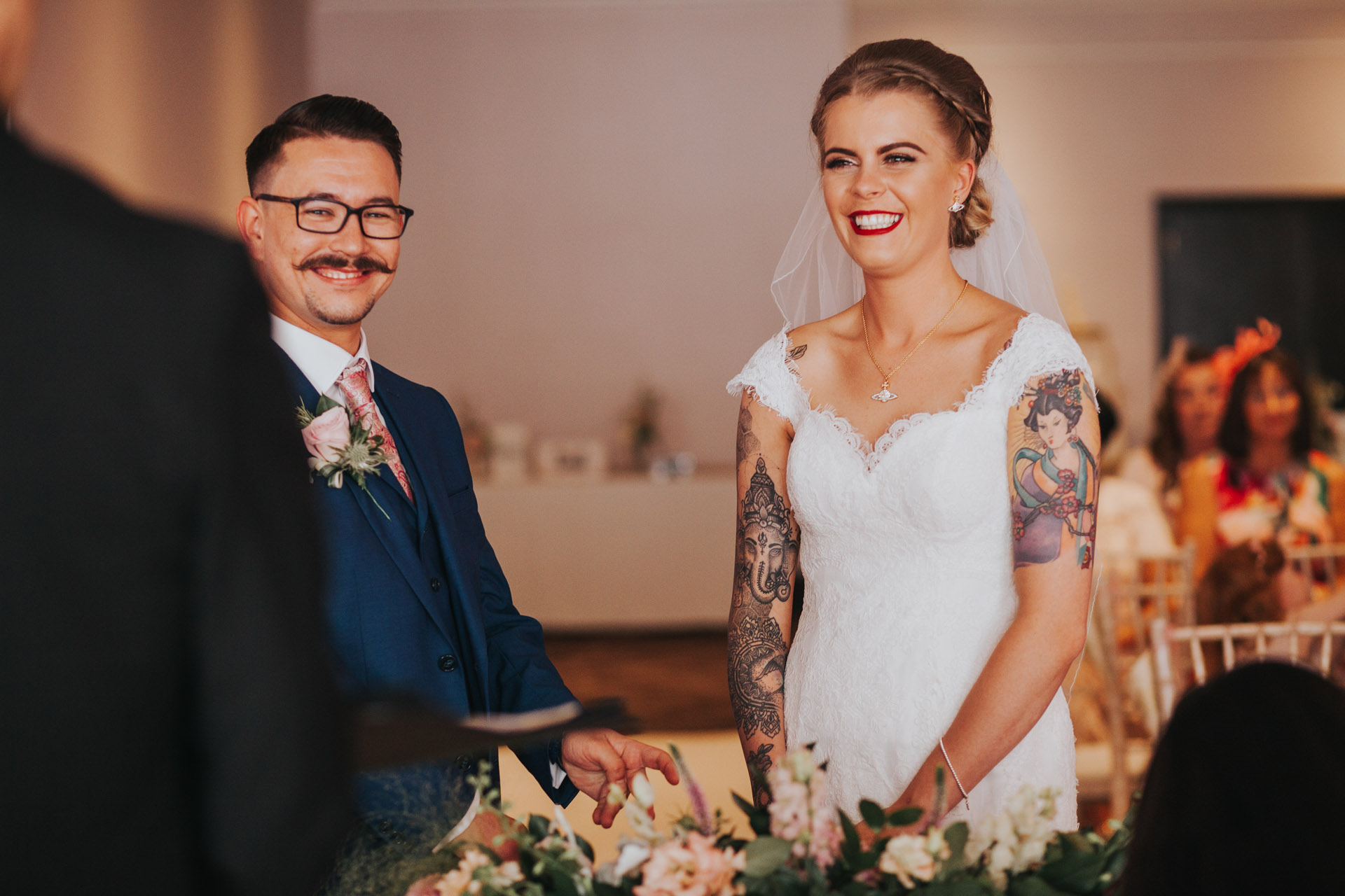 Bride and groom look happy on their wedding day in Manchester