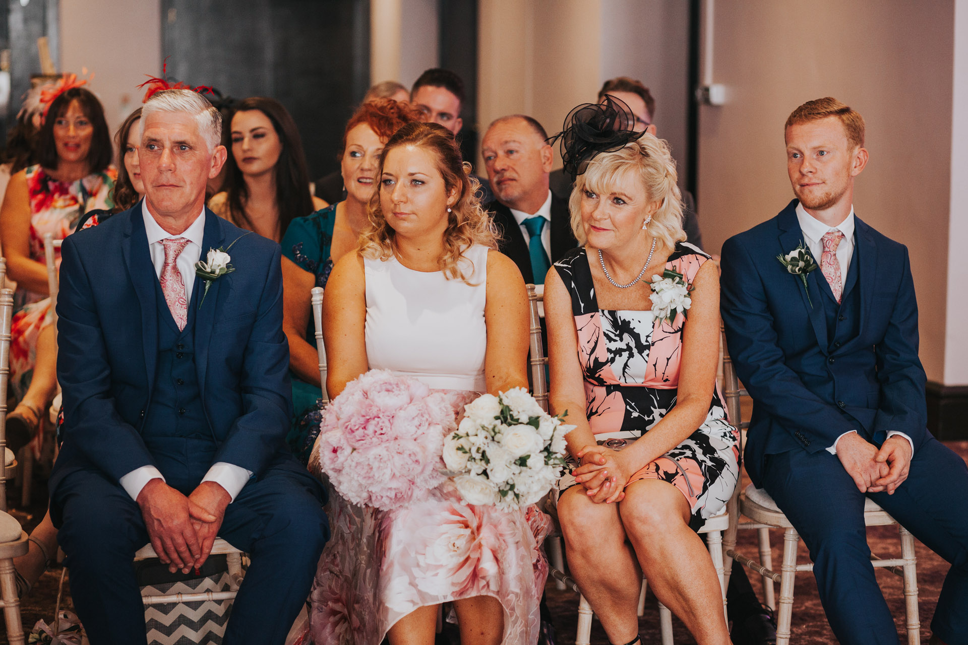 Brides family look emotional as they watch ceremony.