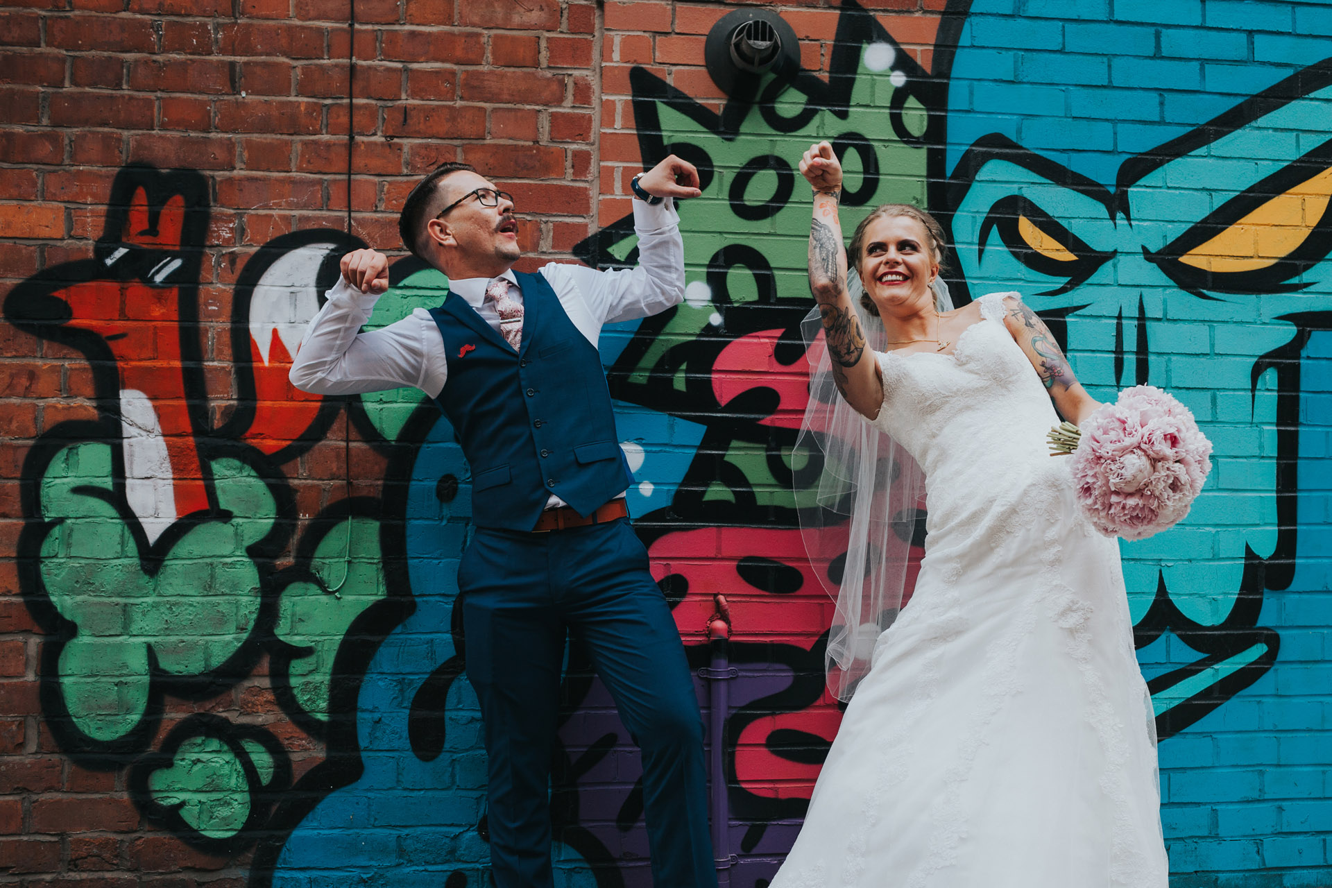 Bride and Groom having fun in Manchester alley.