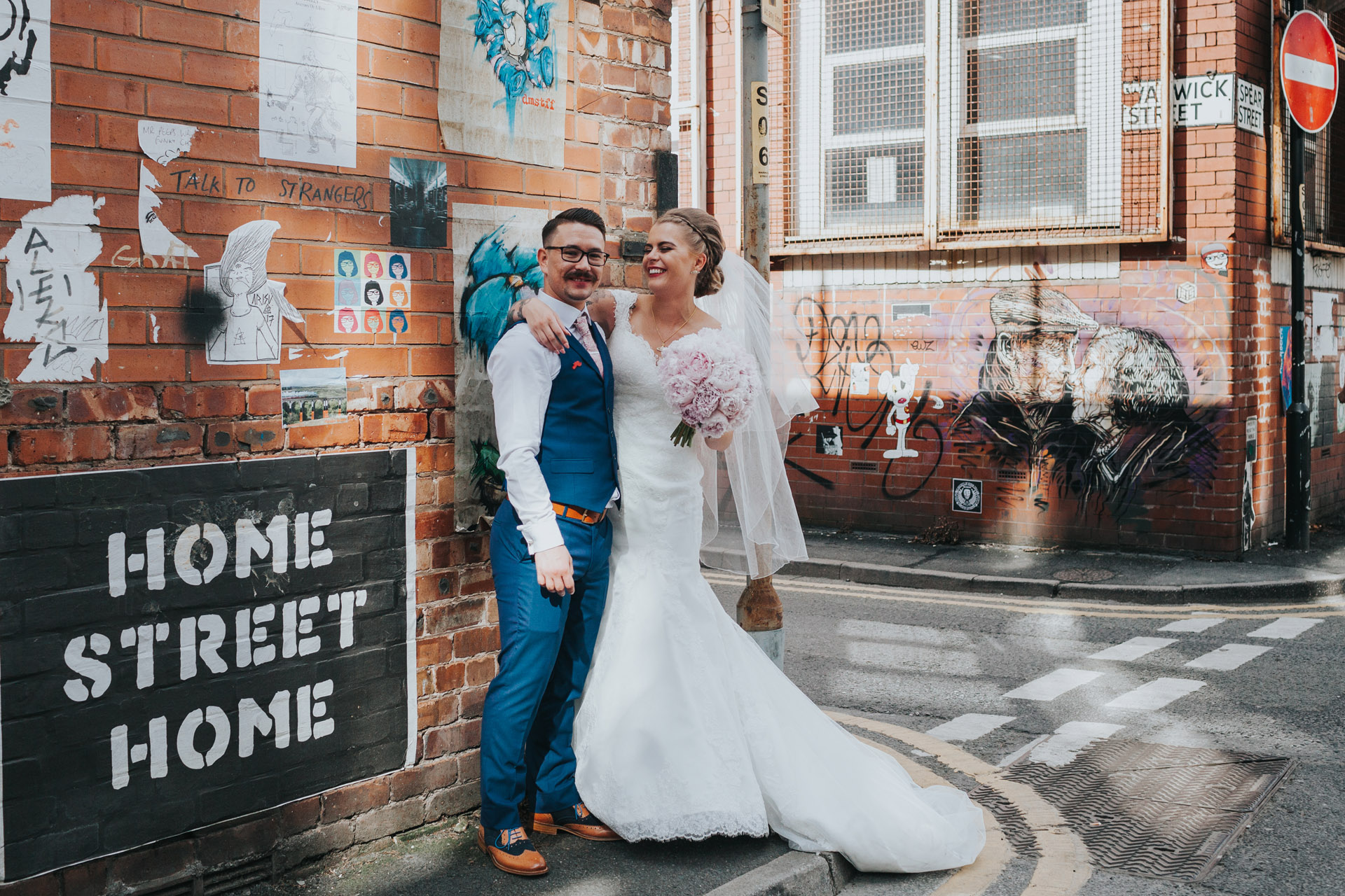 Bride and Groom stand on Warwick Street, Manchester for photograph.