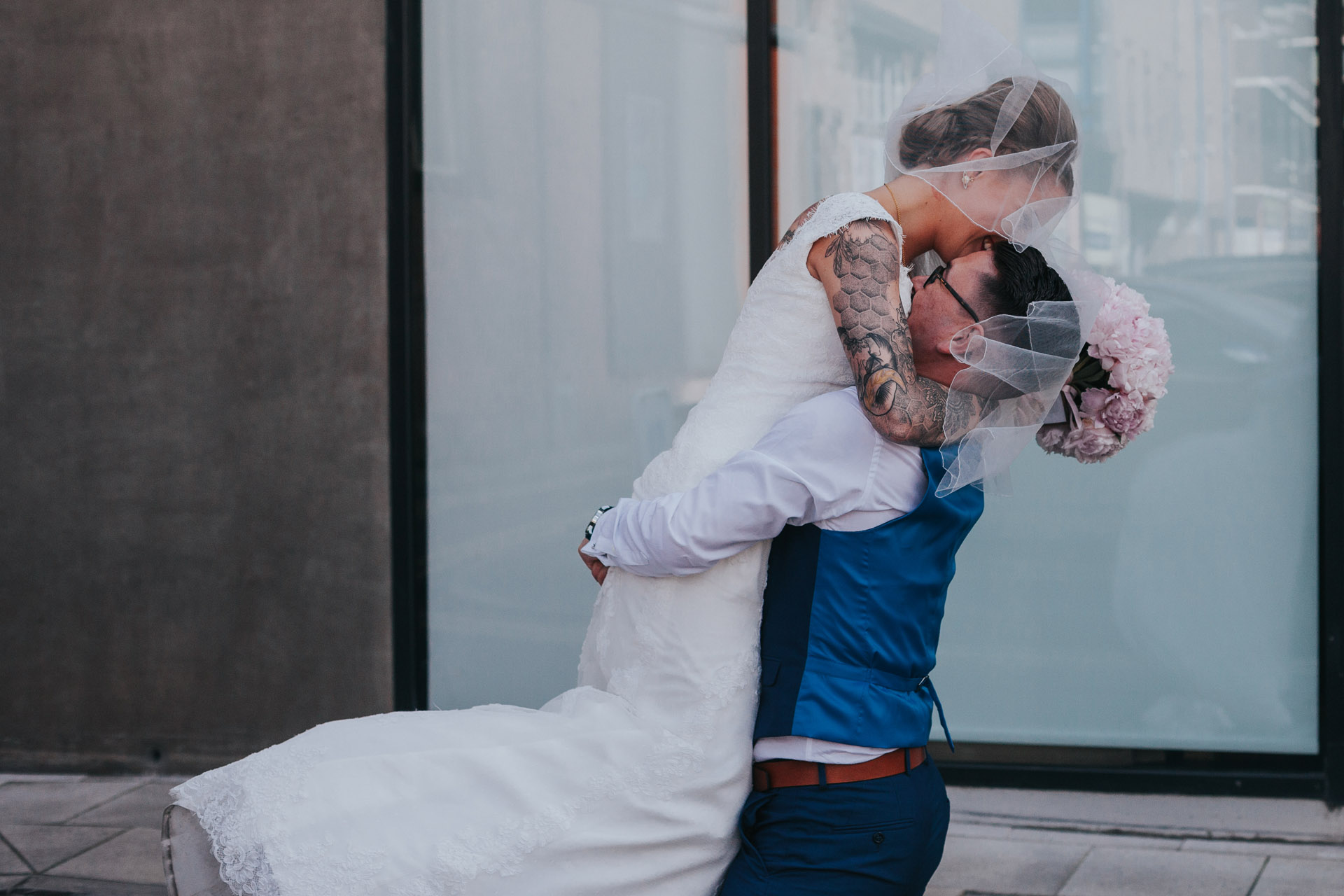 Groom lifts up bride.