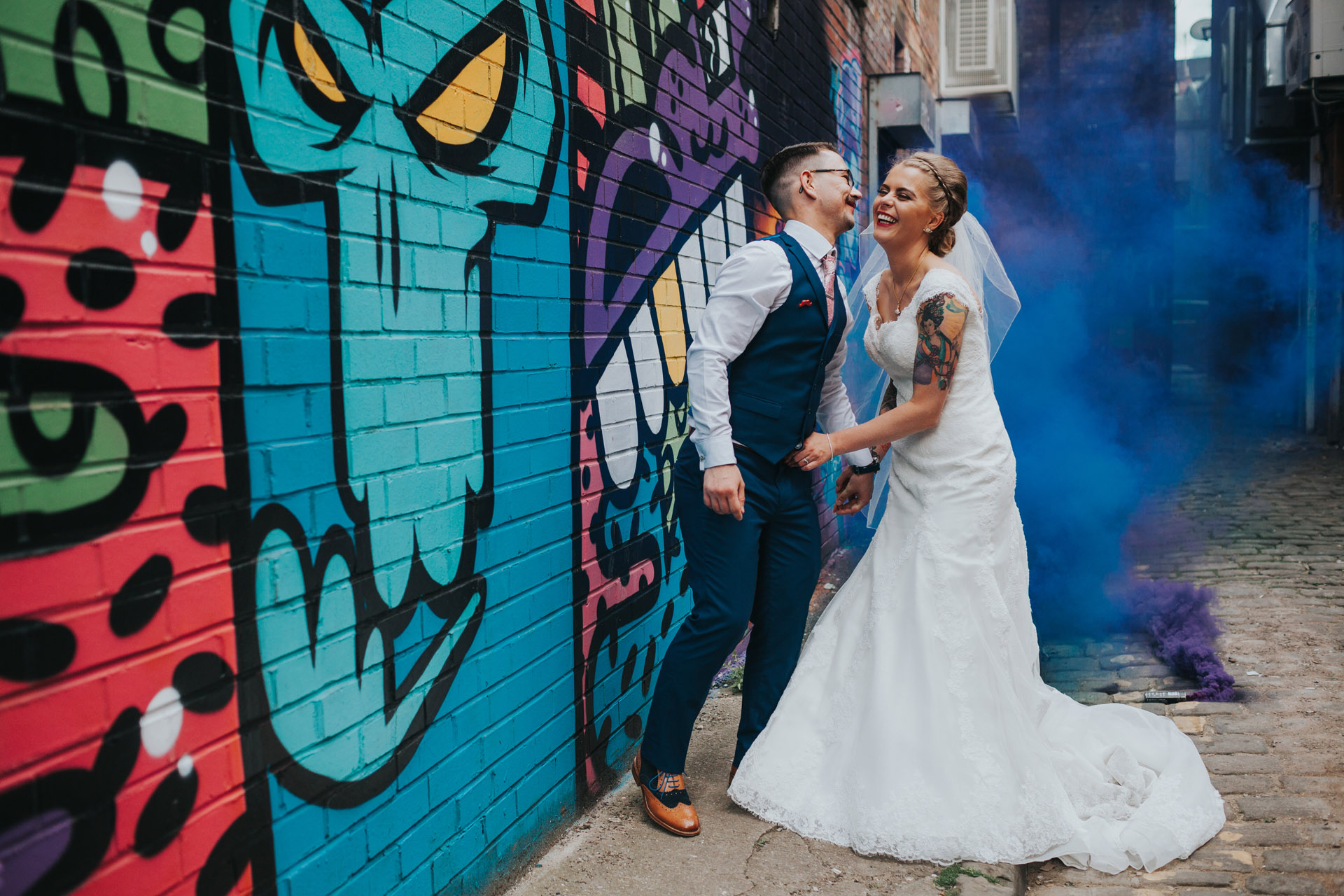 Bride and Groom with smoke bombs in Manchester.