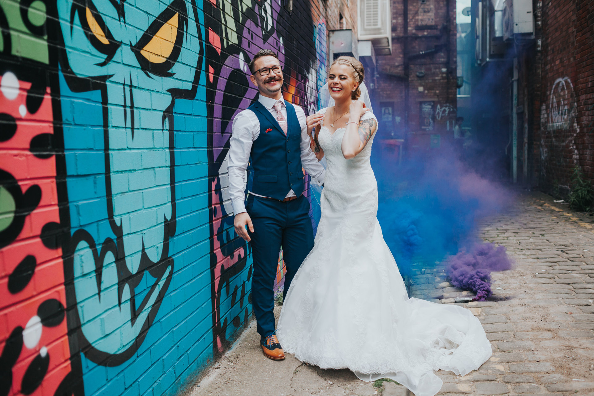 Bride and Groom in front of graffiti in Manchester.