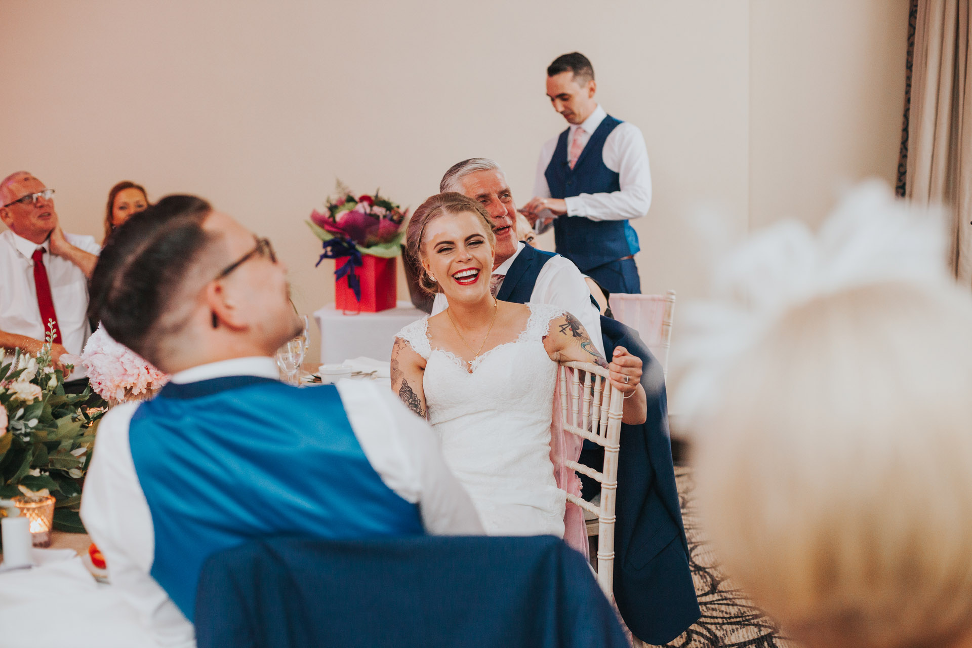 Bride laughing at best mans speech.