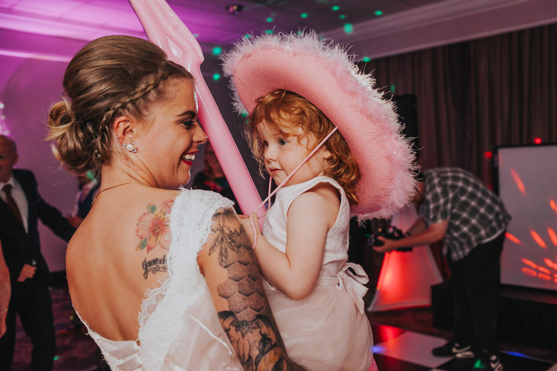 Bride dancing with flower girl.