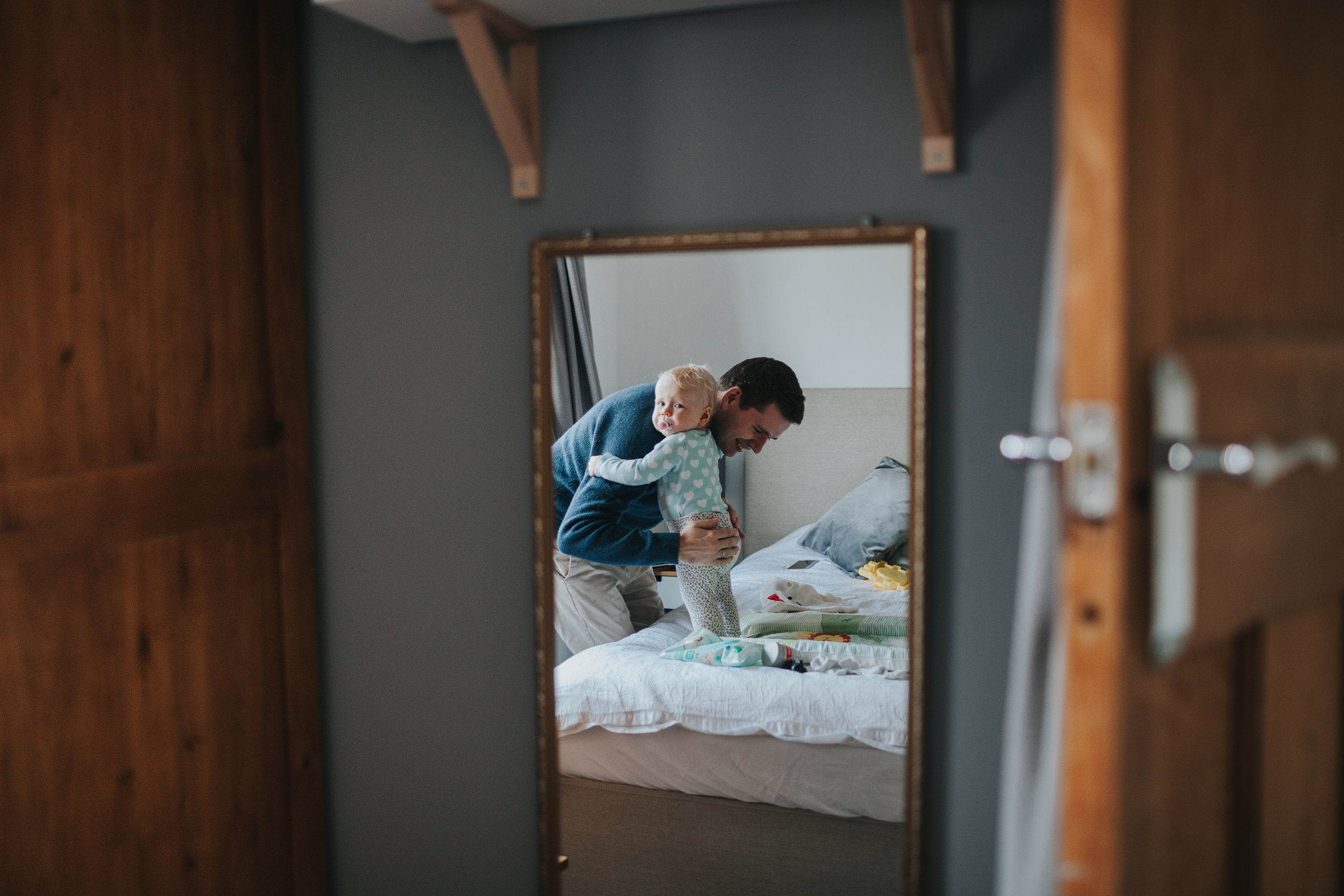 Reflection of father and daughter in mirror