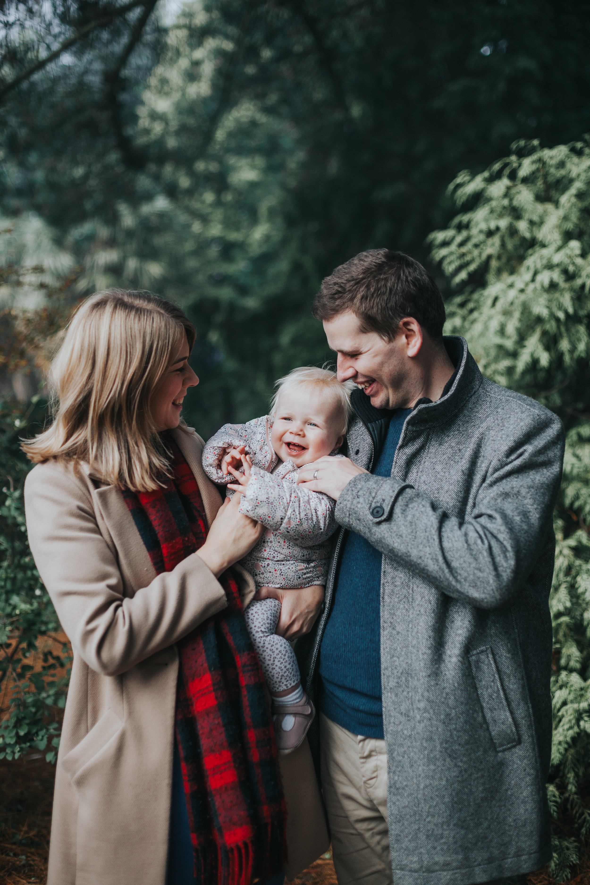 Evie giggling in family photo.