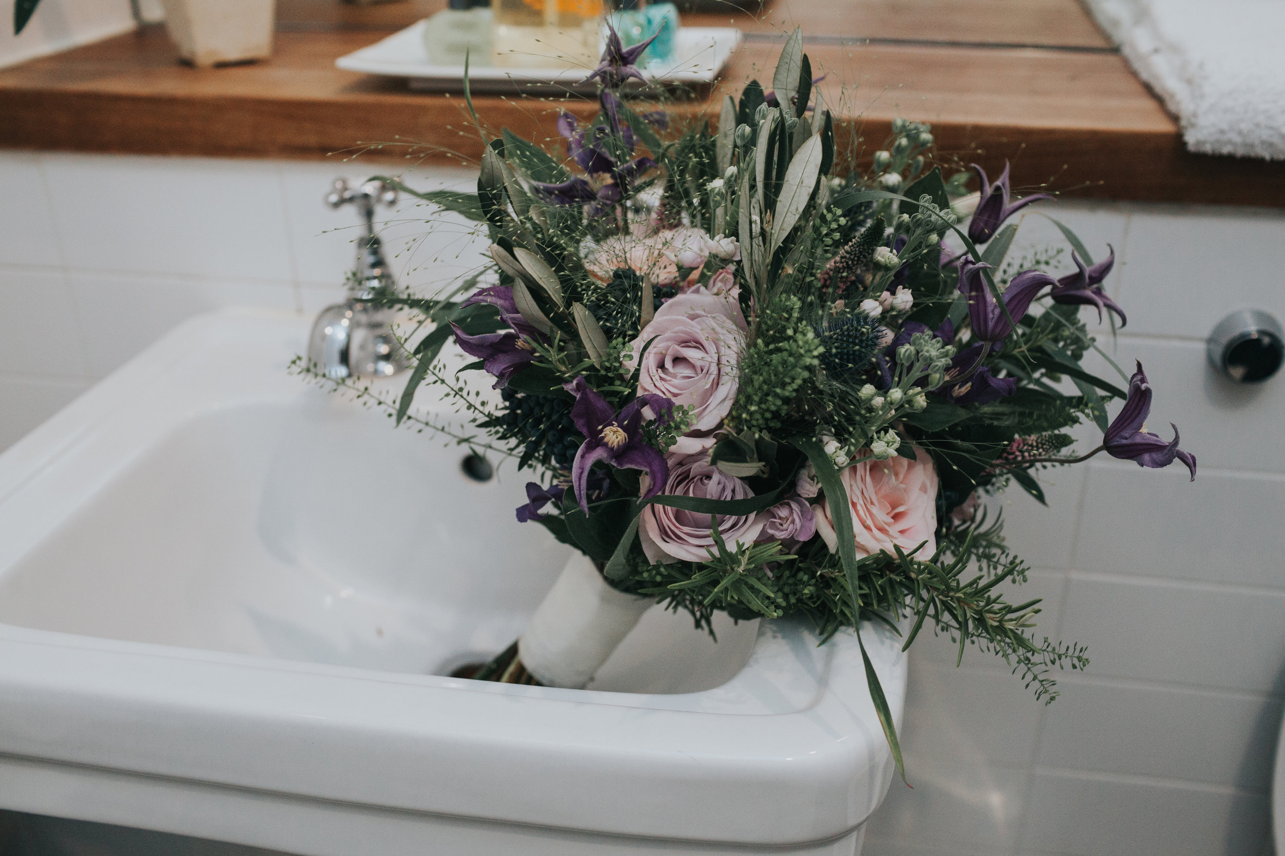Flowers in sink of hotel room in The Racquet Club Liverpool.