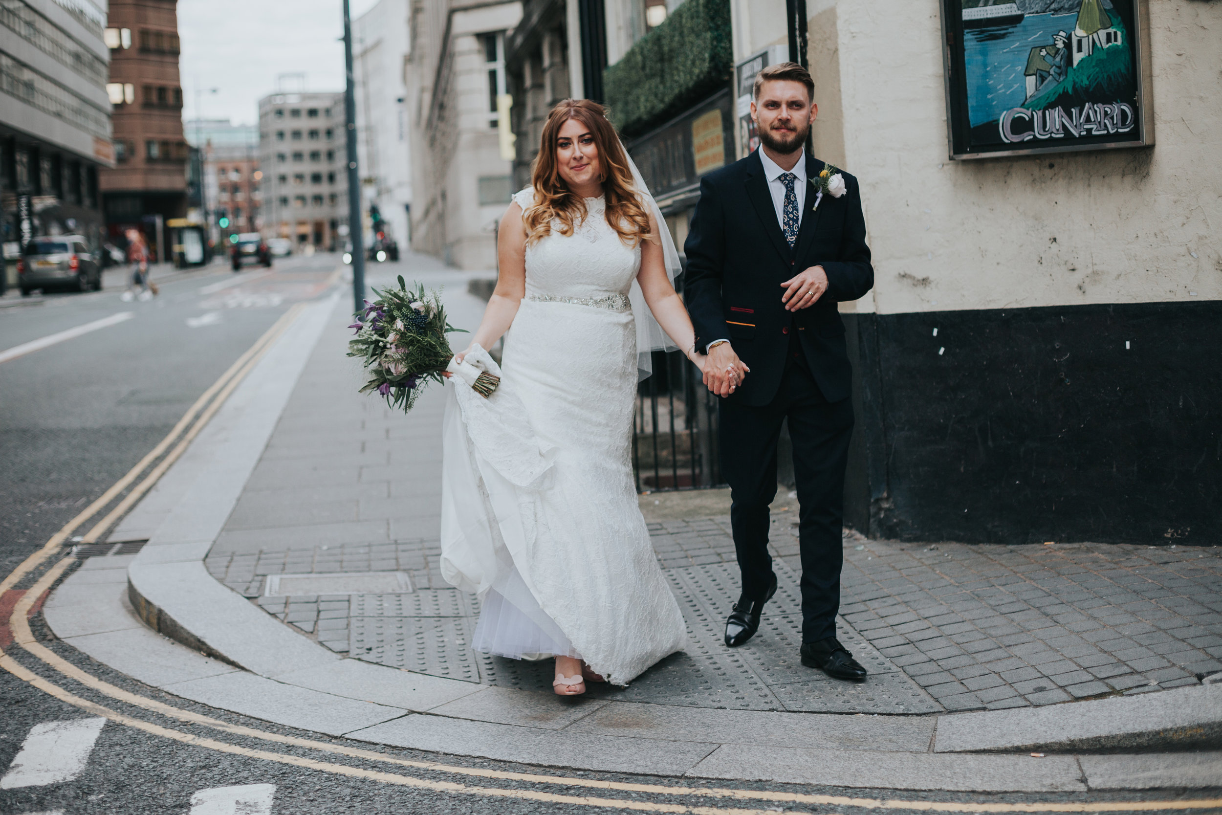 Becca and Sean walking through the street is Liverpool.