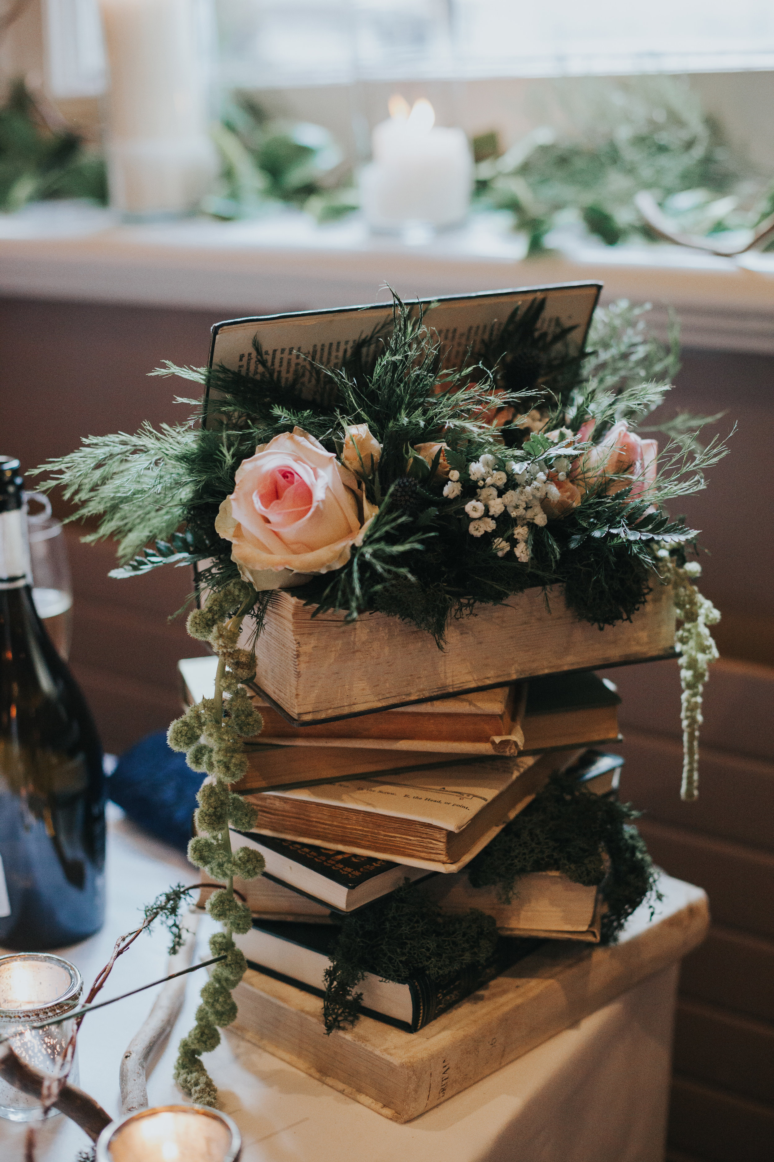 Books stacked with roses.