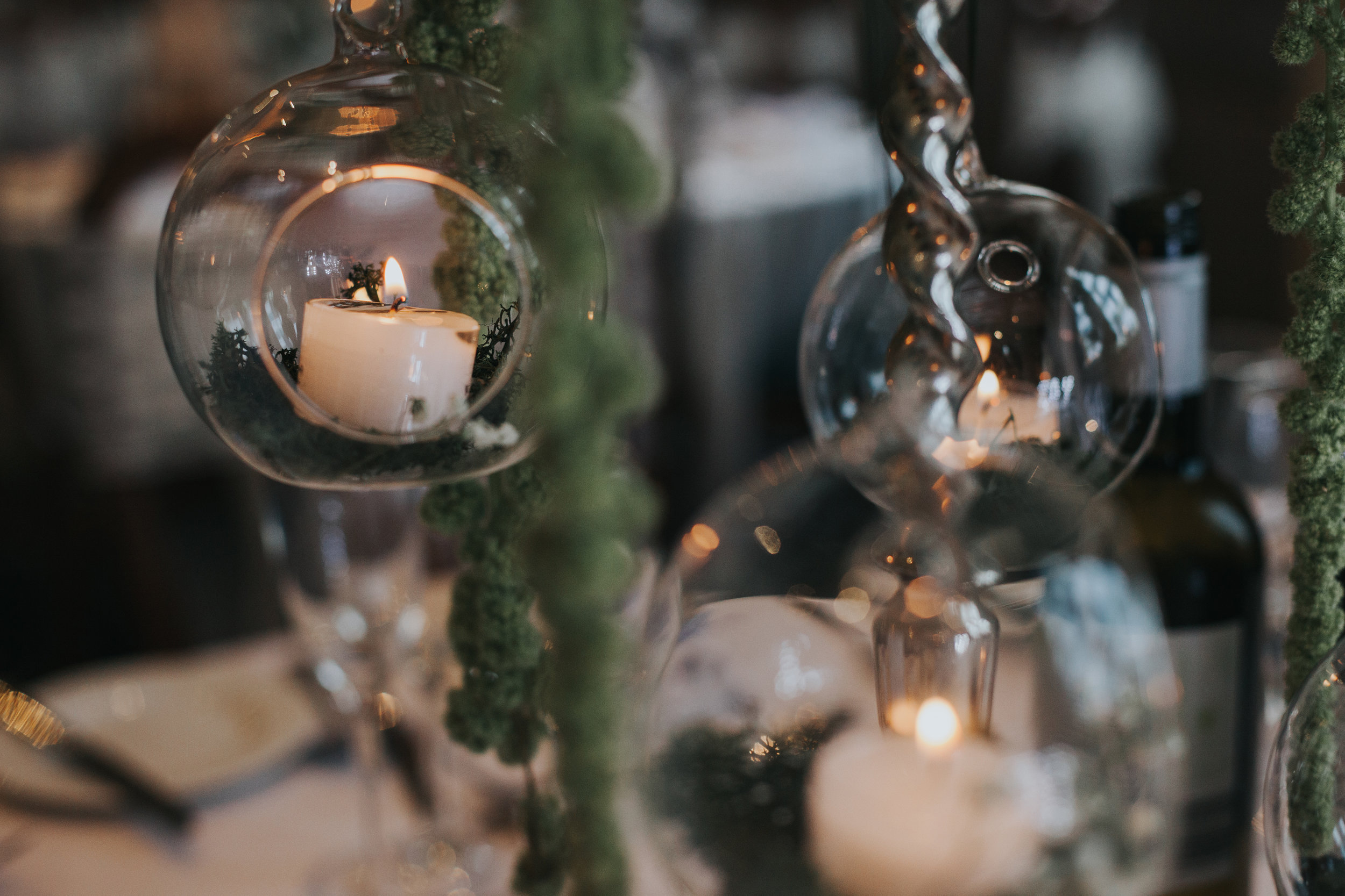 Candles in glass domes.