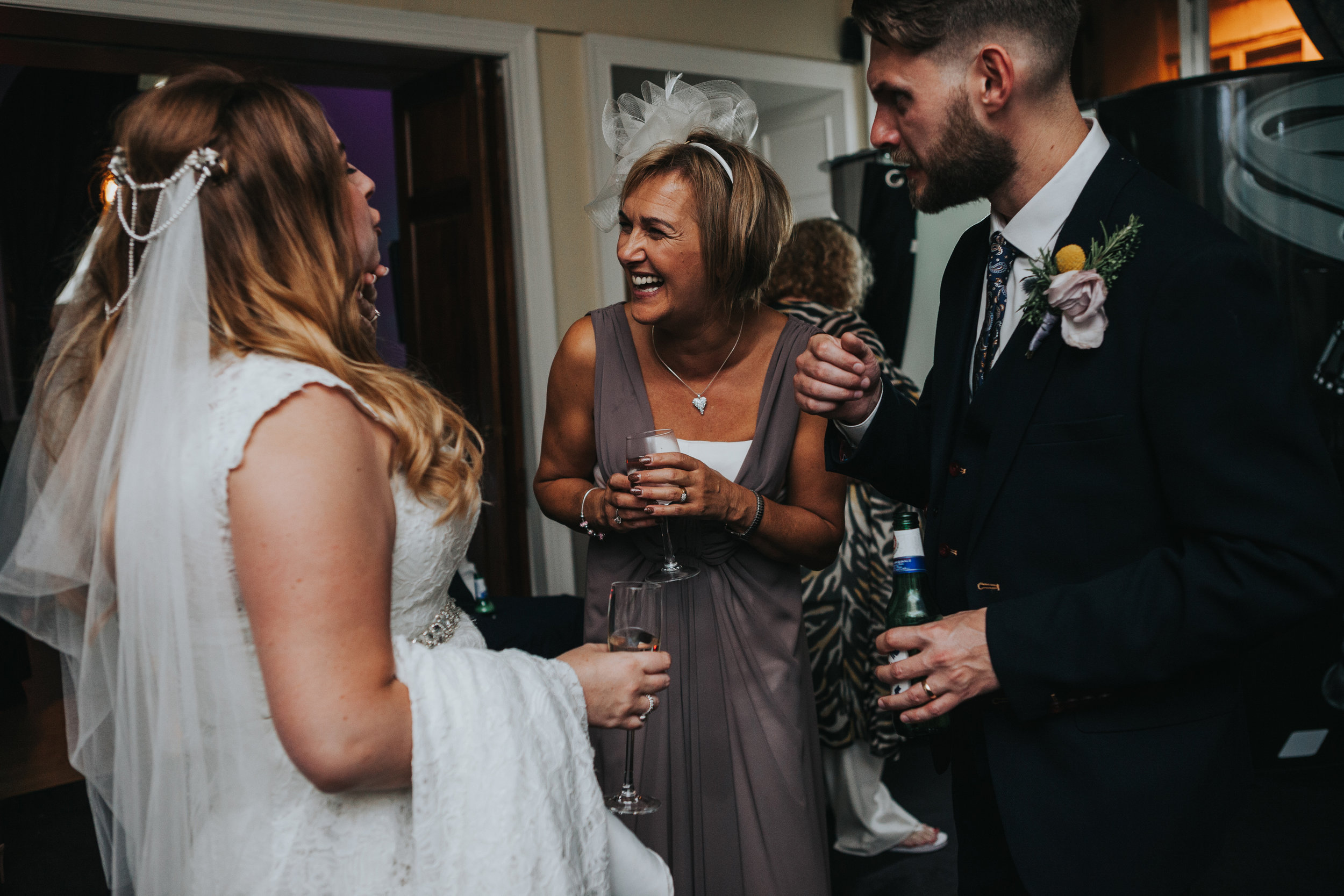 Bride laughs with Wedding Guest.