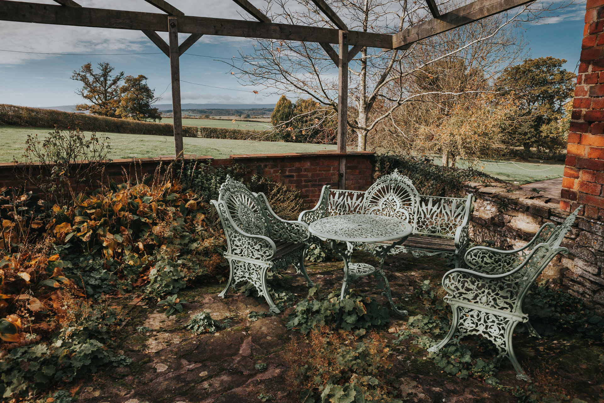 A table and chairs outdoors at Dewsall Court, Callow