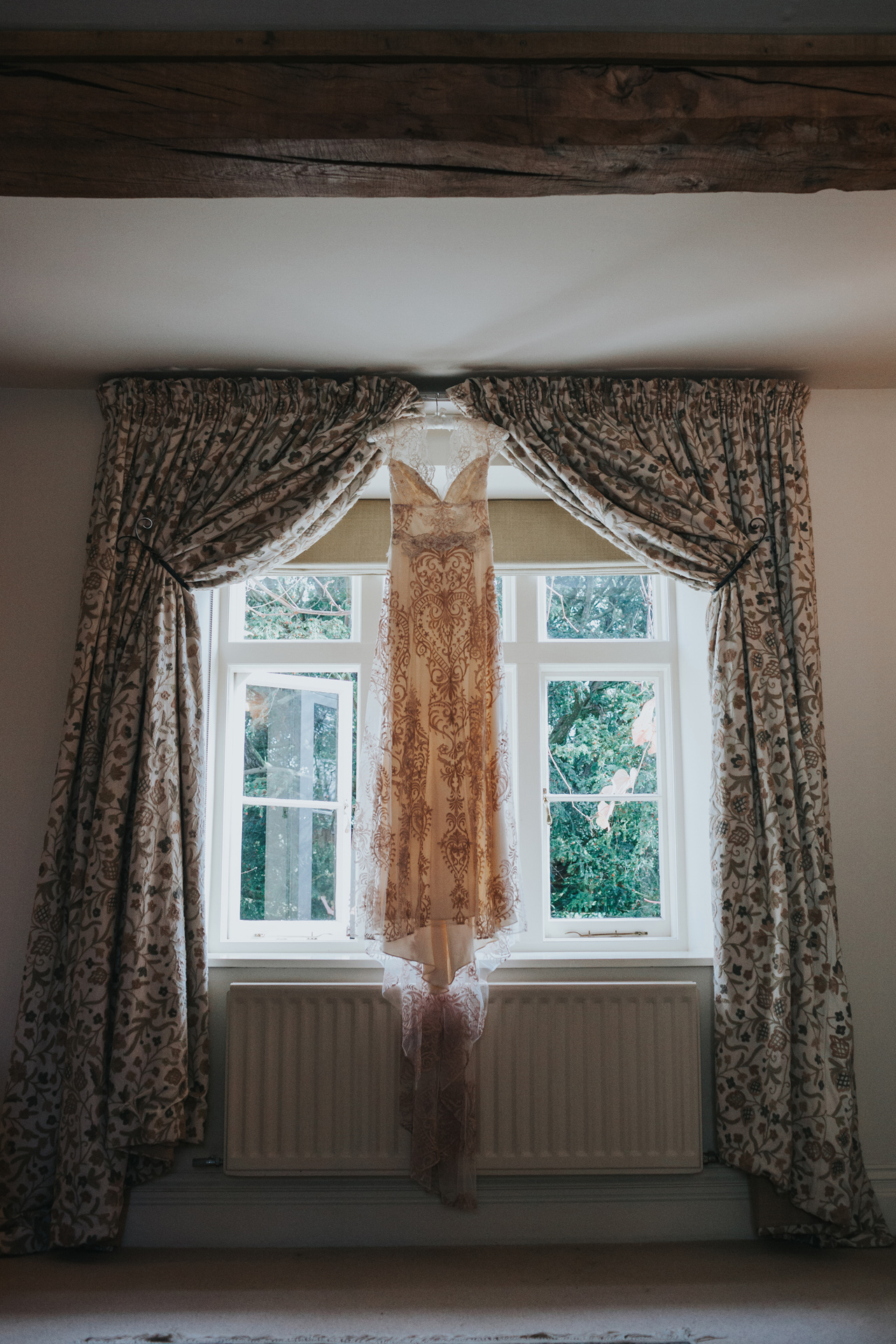 The dress hanging from the curtain rail at Dewsall Court.