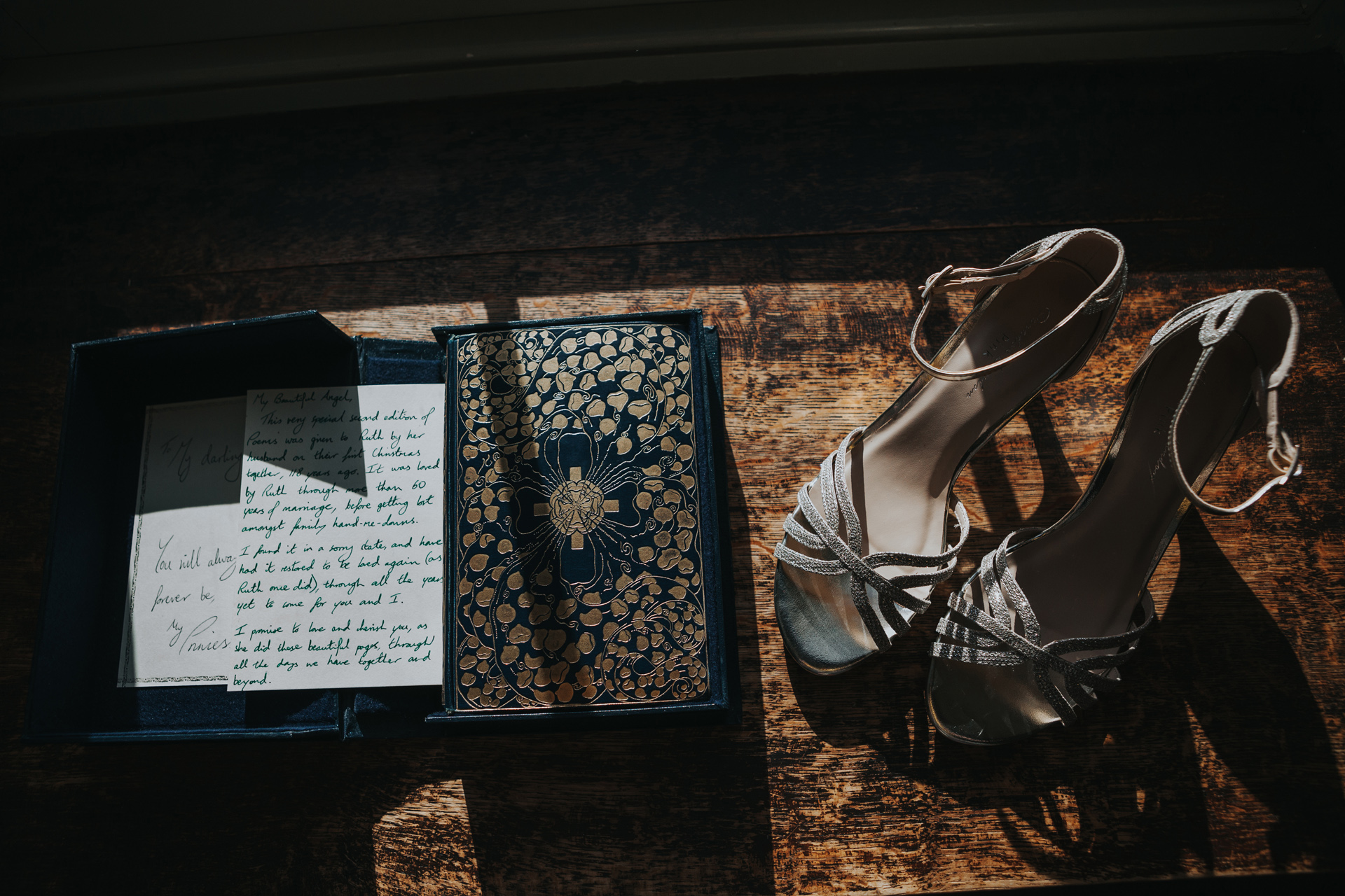 First Edition Wedding present and wedding shoes in hard light.