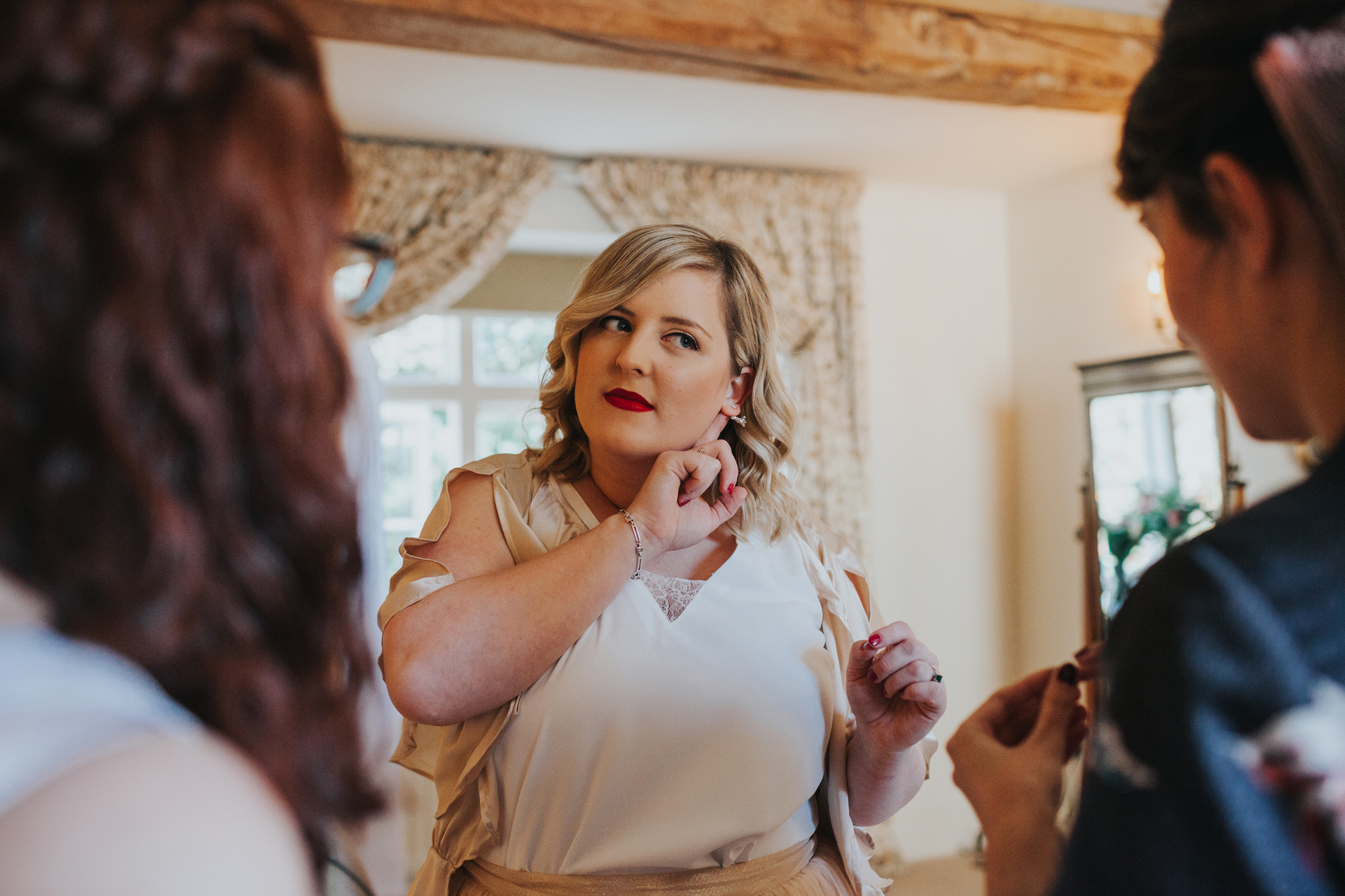 Bridesmaid shows off her ear ring.