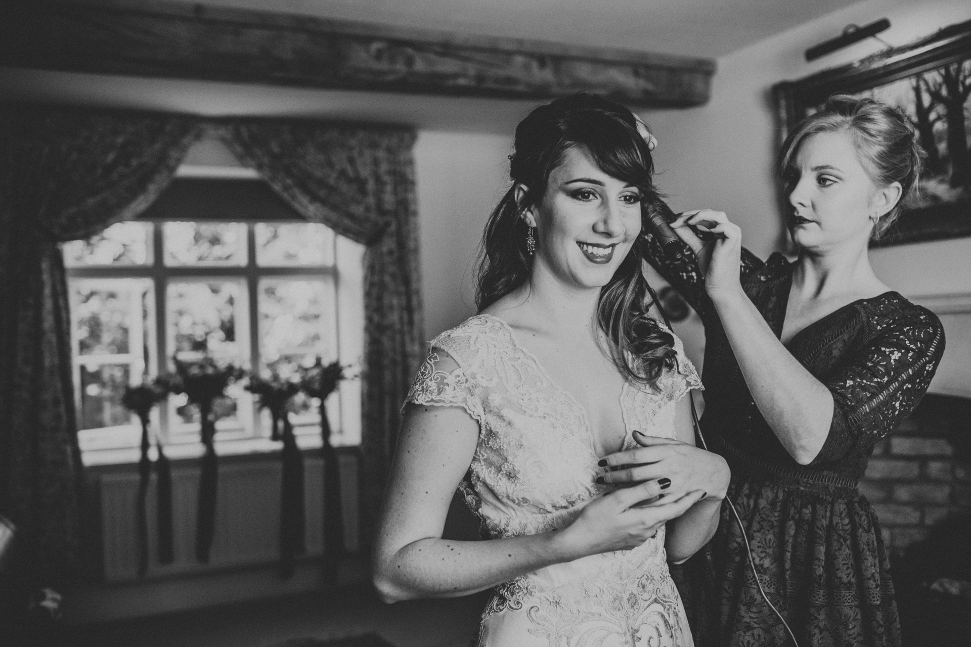 The bride looking excited about the day ahead. Photograph in black and white.