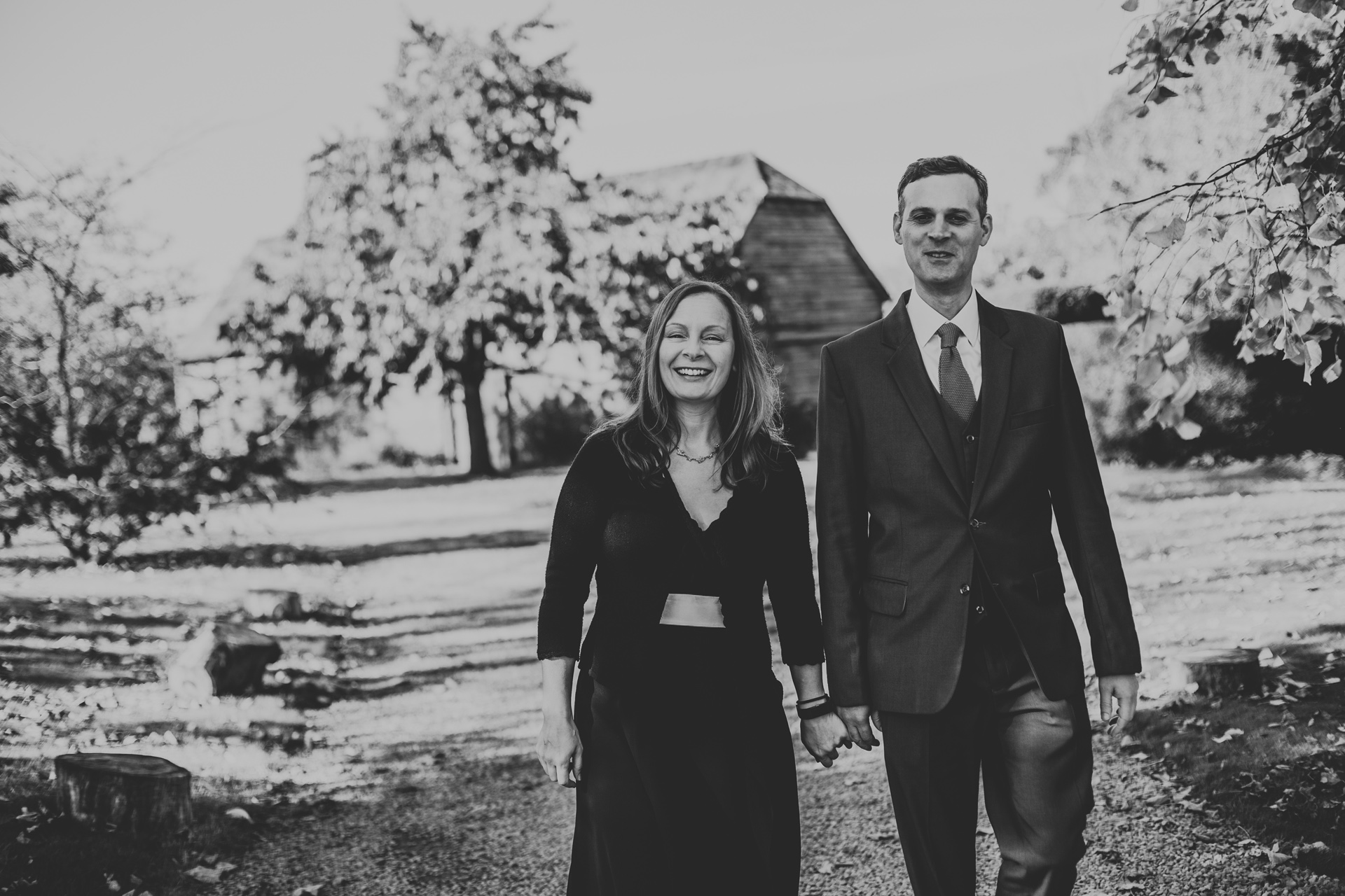 Wedding guests walking hand in hand. Photograph in black and white.
