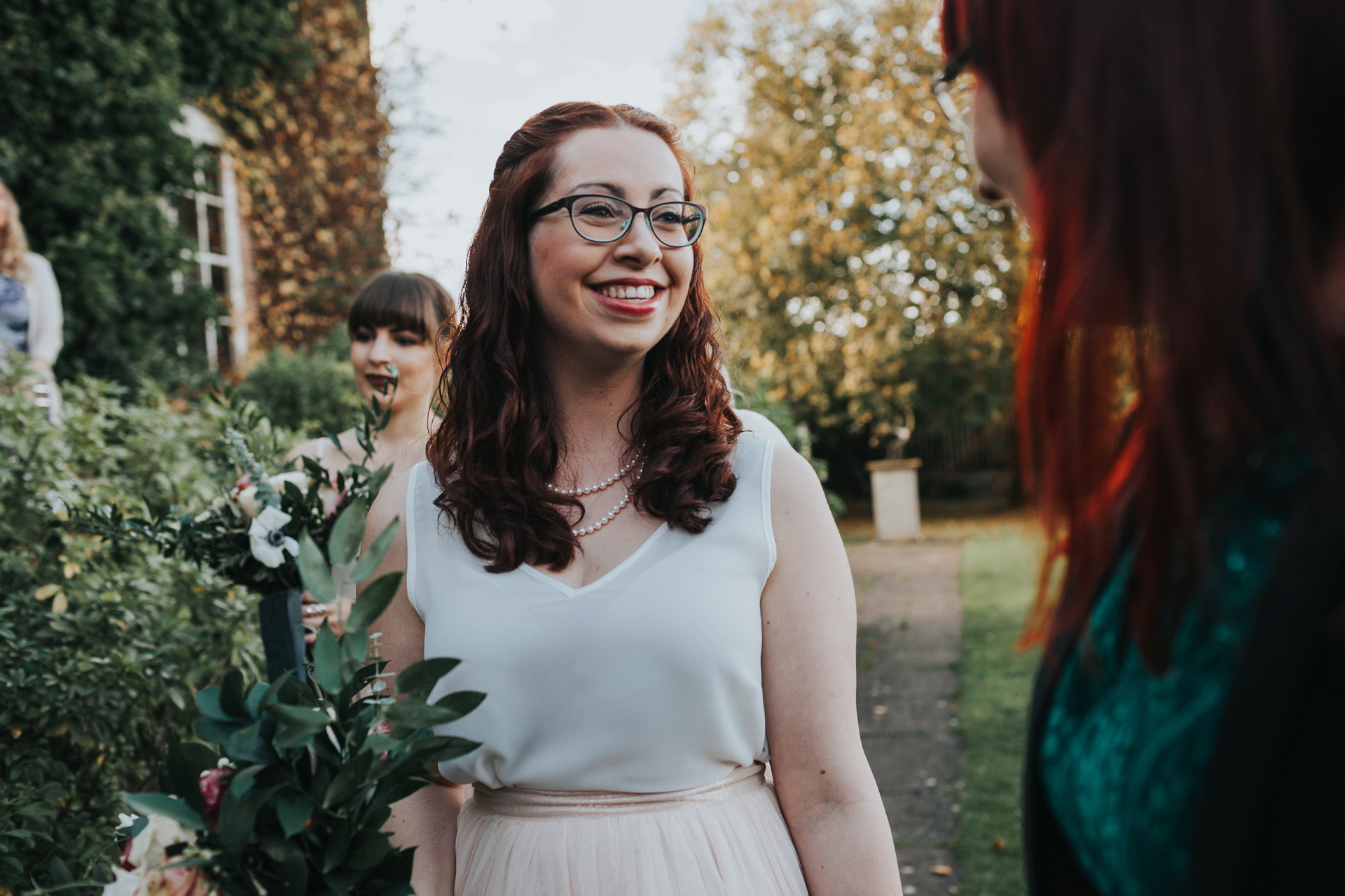 Bridesmaid chatting with friends.