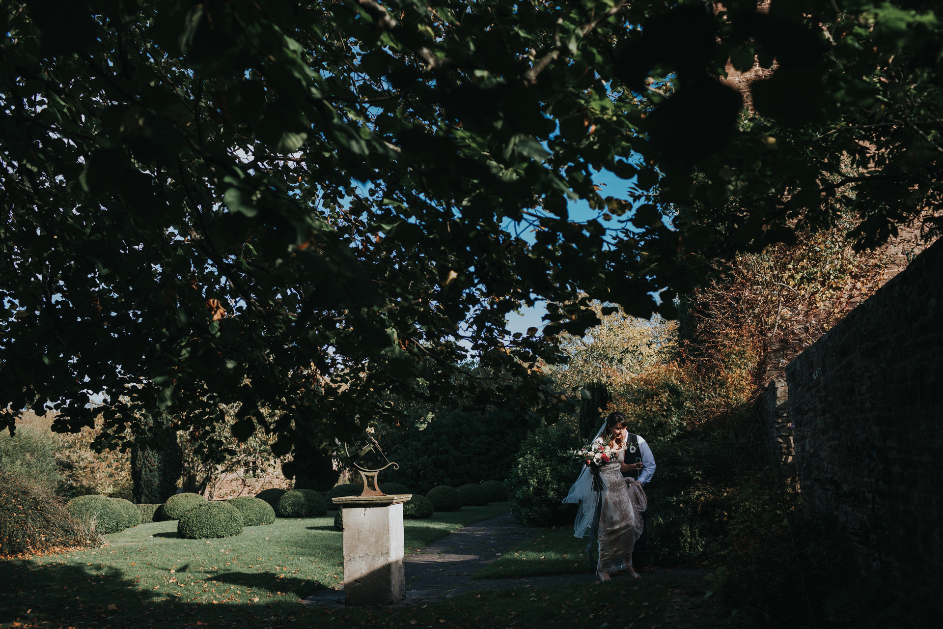 The couple walk through the grounds at Dewsall Court.