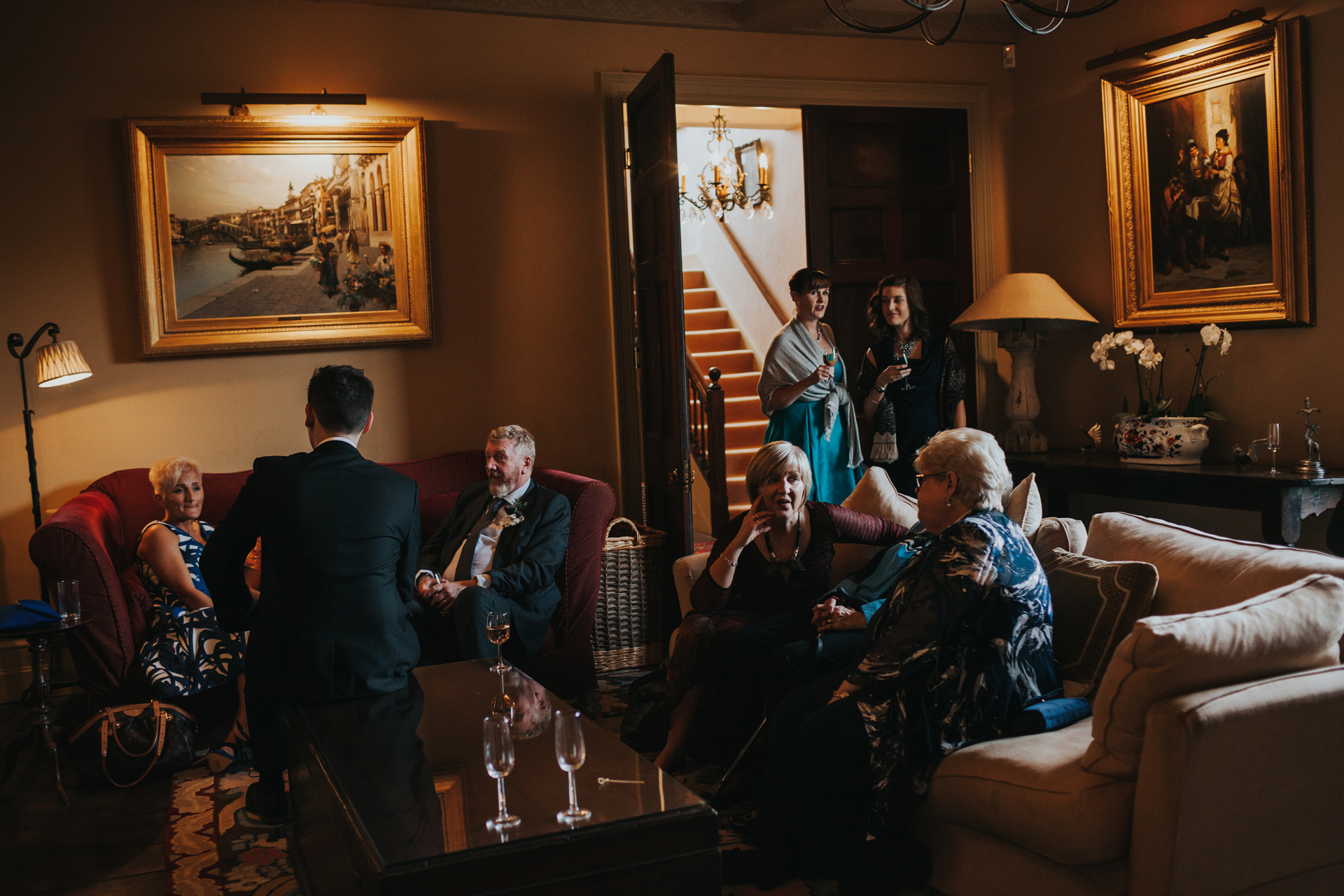 Wedding guests enjoying the main sitting room at Dewsall Court.