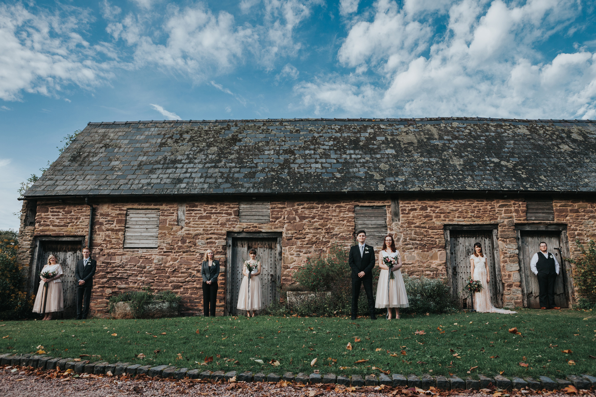 Bridal Party Photo at outside stables at Dewsall Court.